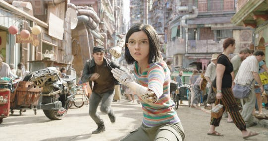 "Keean Johnson (left) and Rosa Salazar (center) in ""Alita: Battle Angel."""