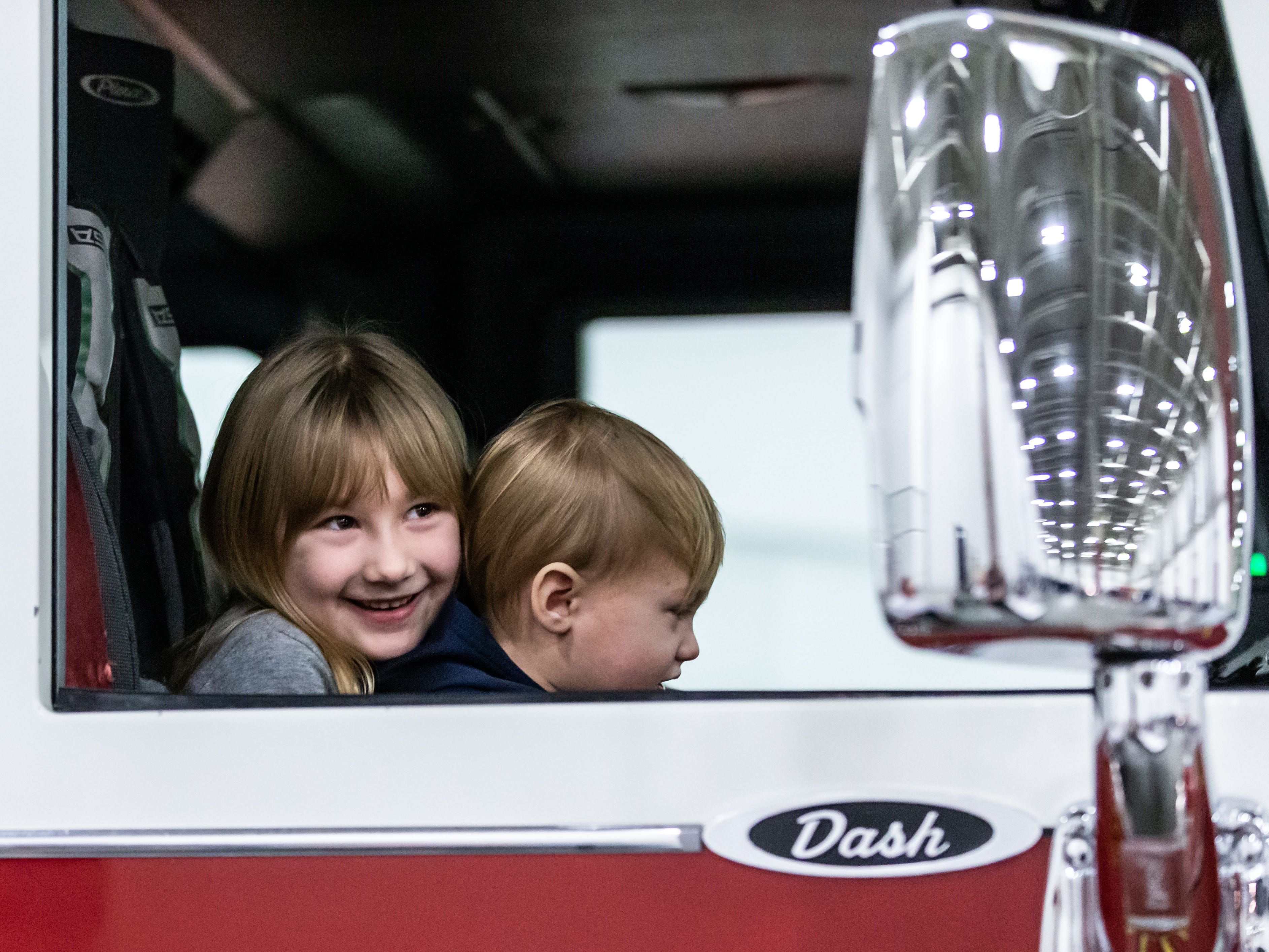 Six-year-old Sadie Lesnik of Milwaukee and her brother Charlie, 1, check out the inside of a West Allis fire truck during the Milwaukee Kids Expo at State Fair Park in West Allis on Sunday.
