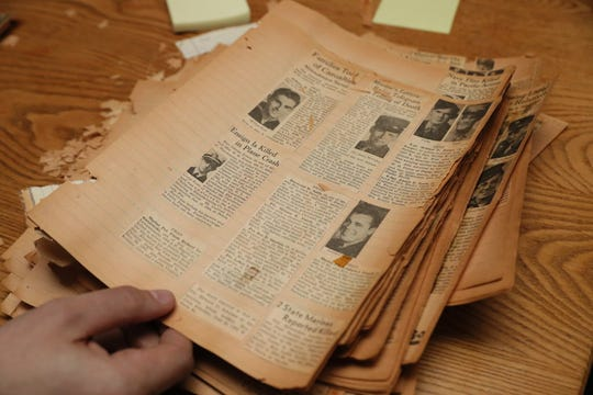 Old newspaper clippings bring sad news of the deaths of service members.  These are being researched to glean more information for the project.