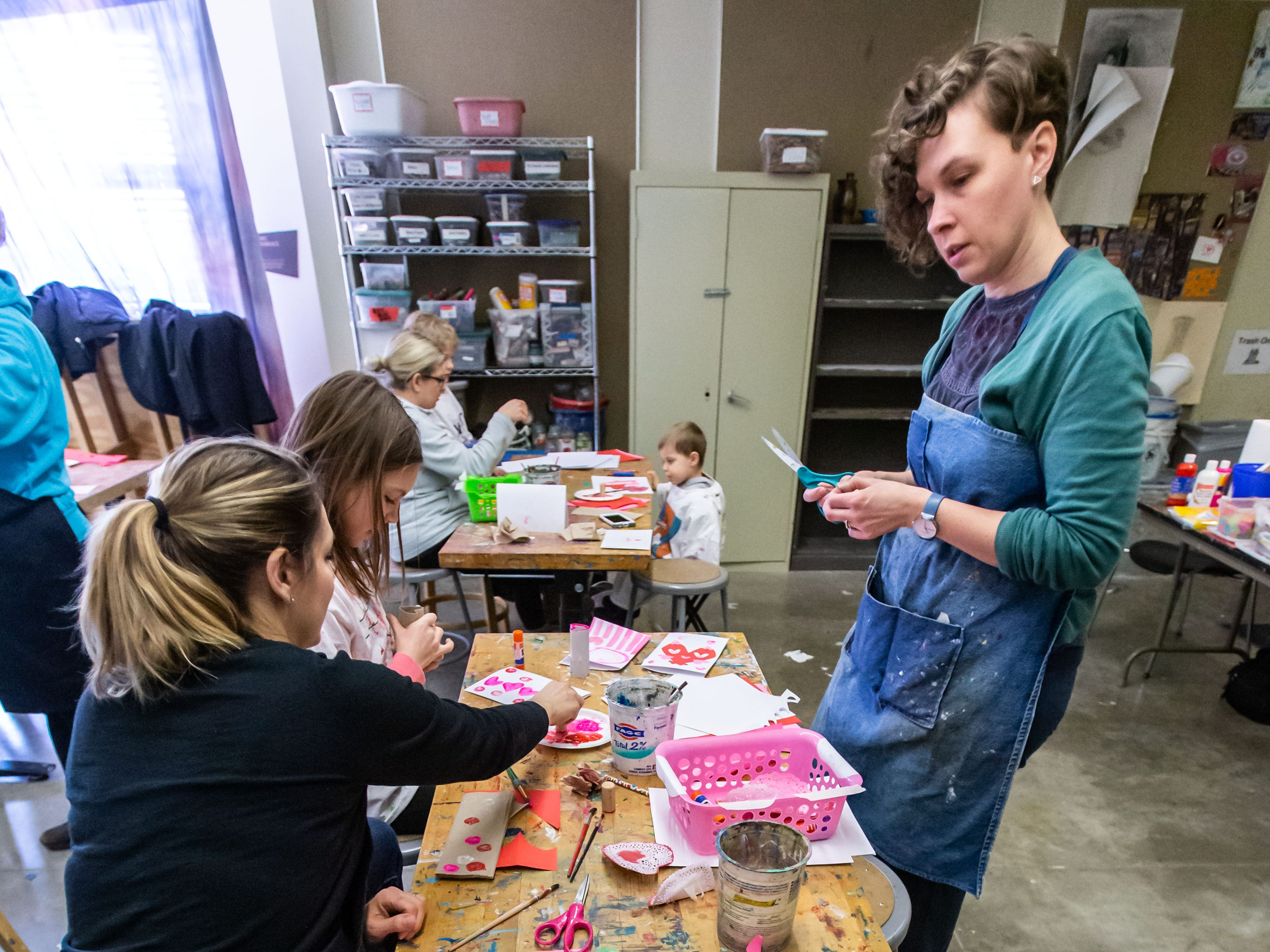 Burlington artist Tiffany Knopow (right) answers questions on creating printed Valentine's Day cards during the Free Family Art Workshop at the Sharon Lynne Wilson Center for the Arts in Brookfield on Saturday, Feb. 9, 2019. The free art workshops are held from 10 a.m. to noon on the second Saturday of each month. For more info visit wilson-center.com/classes.