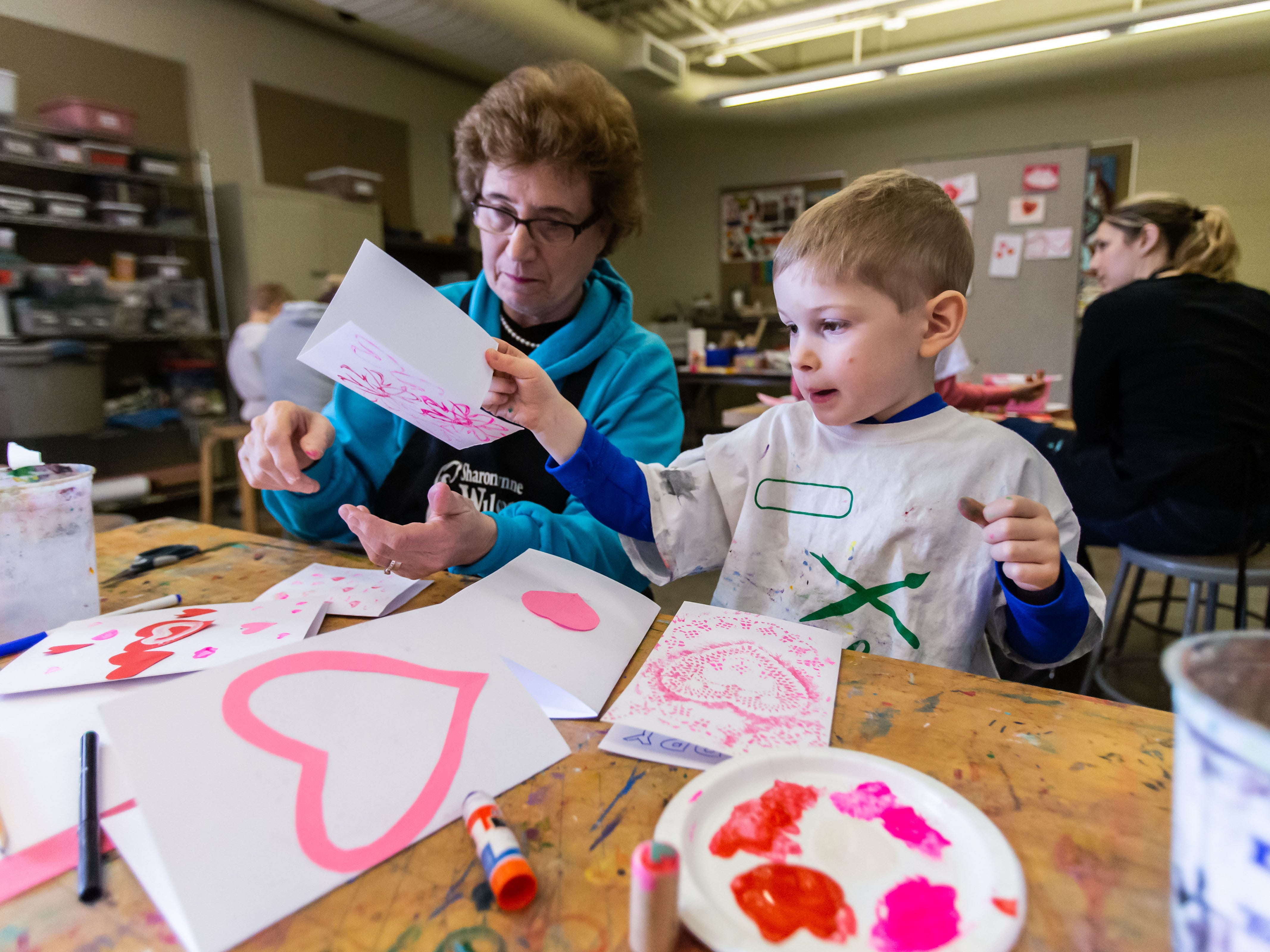 Ben Banach of Greenfield and his grandmother Carol Banach create printed Valentine's Day cards during the Free Family Art Workshop at the Sharon Lynne Wilson Center for the Arts in Brookfield on Saturday, Feb. 9, 2019. The free art workshops are held from 10 a.m. to noon on the second Saturday of each month. For more info visit wilson-center.com/classes.