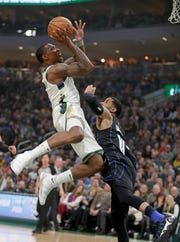 Bucks guard Eric Bledsoe  drives to the basket against Magic guard D.J. Augustin.