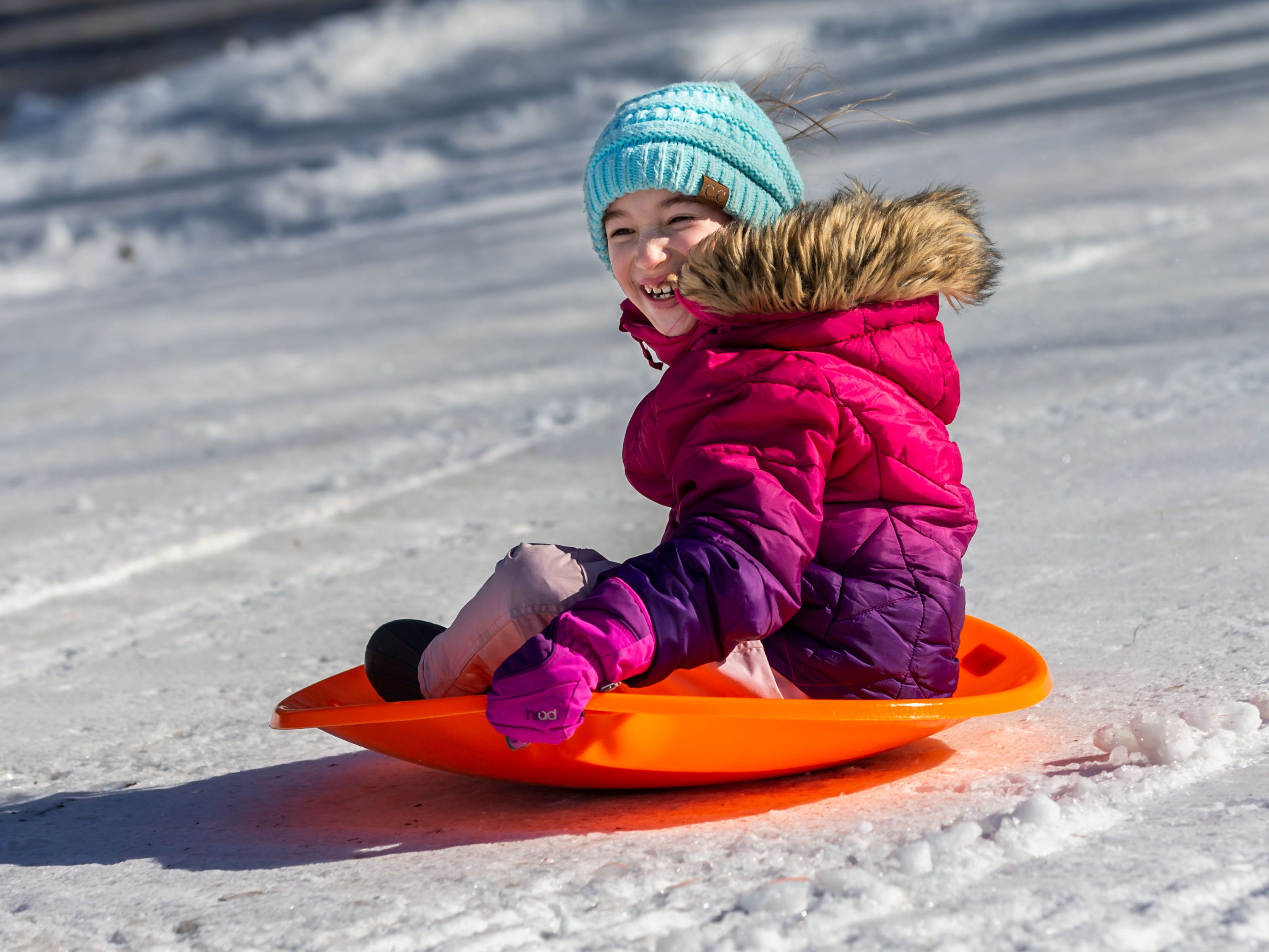 Hannah Callister, 8, of Lisbon zooms down the sledding hill during the annual Winterfest at Lisbon Community Park on Saturday, Feb. 9, 2019. The free event includes ice skating, sledding, skiing, a bonfire, a warming tent with free refreshments, hot dogs and s'mores.