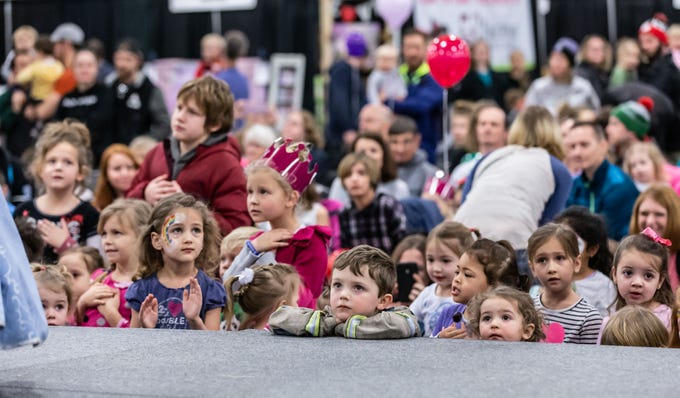Youngsters watch a performance by the Fairytale Birthday Company Princesses during the Milwaukee Kids Expo at State Fair Park in West Allis on Sunday, Feb. 10, 2019. The two-day expo featured bounce houses, a petting zoo, a rock climbing wall, pony rides, caricature paintings, a maze challenge and much more.