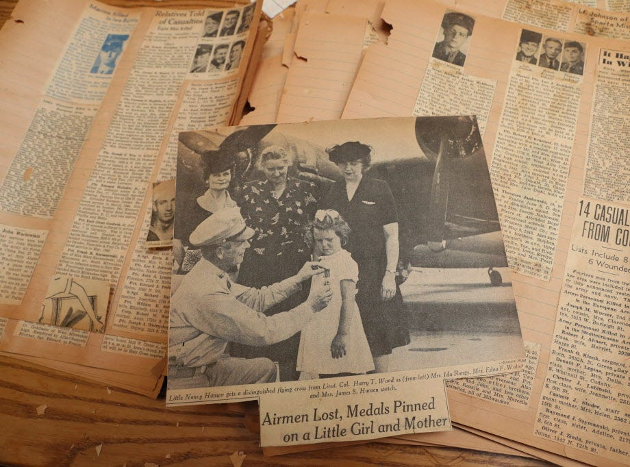 Old newspaper clippings about those killed in combat were being organized and researched.