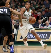 Bucks guard Sterling Brown looks for a crack in the Magic's defense to drive through during the first quarter on Saturday night.