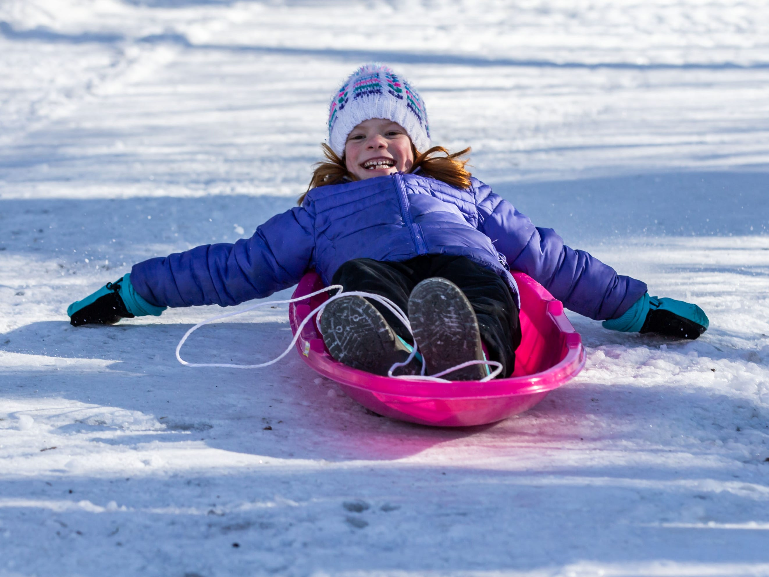 Elsie Ludwig, 7, of Oconomowoc speeds down the sledding hill during the annual Winterfest at Lisbon Community Park on Saturday, Feb. 9, 2019. The free event includes ice skating, sledding, skiing, a bonfire, a warming tent with free refreshments, hot dogs and s'mores.