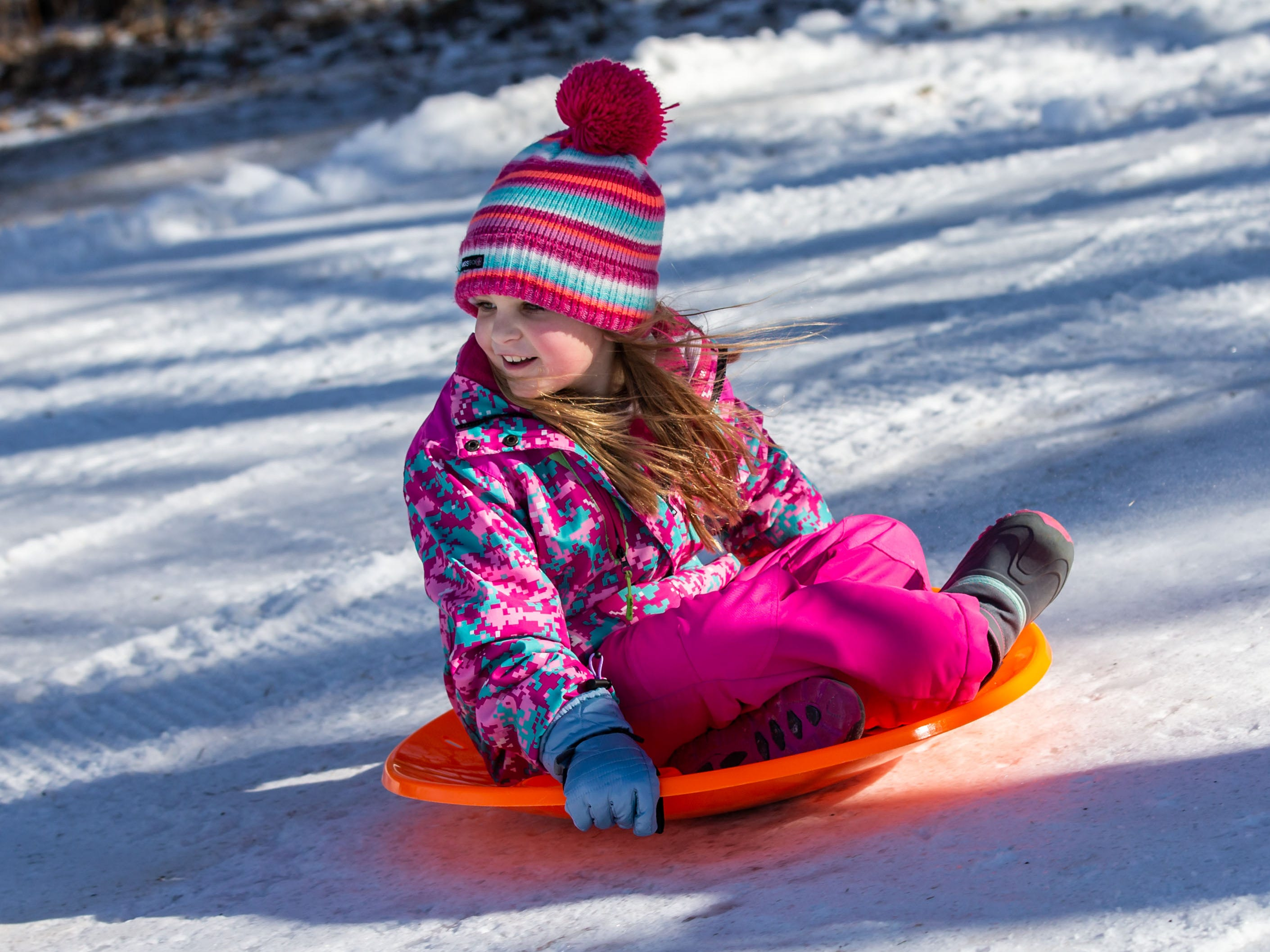 Samantha Gehrke, 8, of Oconomowoc speeds down the sledding hill during the annual Winterfest at Lisbon Community Park on Saturday, Feb. 9, 2019. The free event includes ice skating, sledding, skiing, a bonfire, a warming tent with free refreshments, hot dogs and s'mores.
