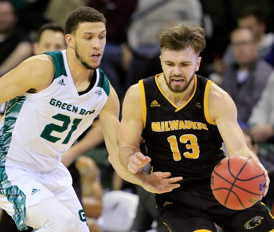 Jake Wright (right, shown in an earlier game at UW-Green Bay) scored 15 points on Saturday against Cleveland State.