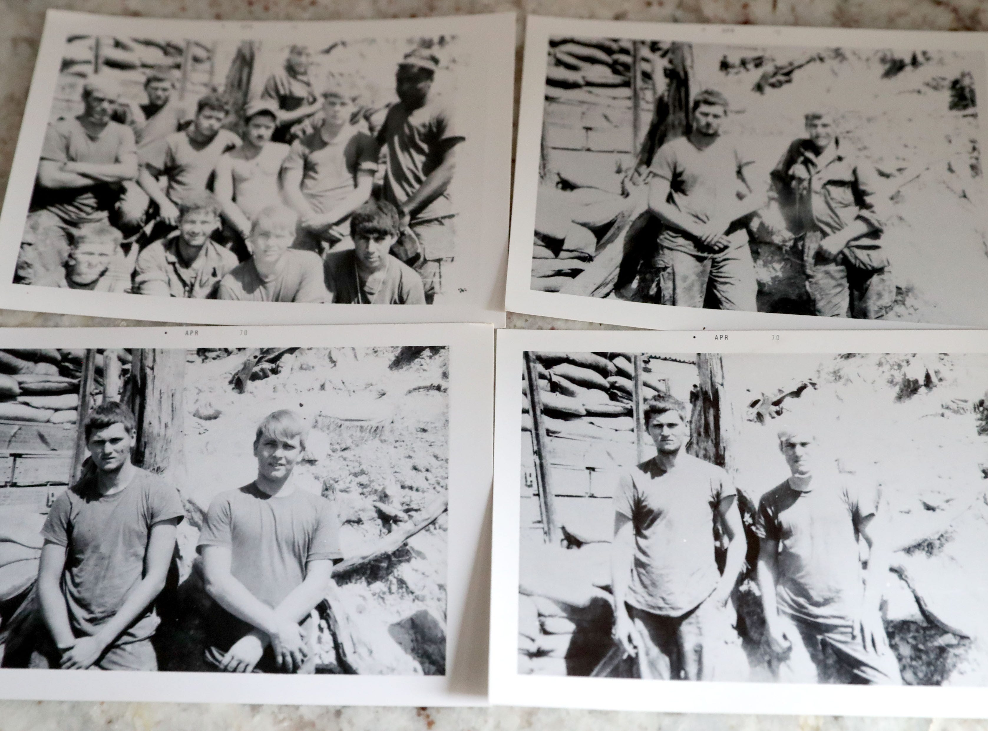 Photos of Wayne R. Thomas (secon left in top left photo and left in the remaining three photos), who was killed in Vietnam three days after his 20th birthday in 1969, is seen at the home of his childhood friend, Gary Weckworth, at Weckworth's home in Glendale. The photos of Thomas are from 1969 while on duty in Vietnam.