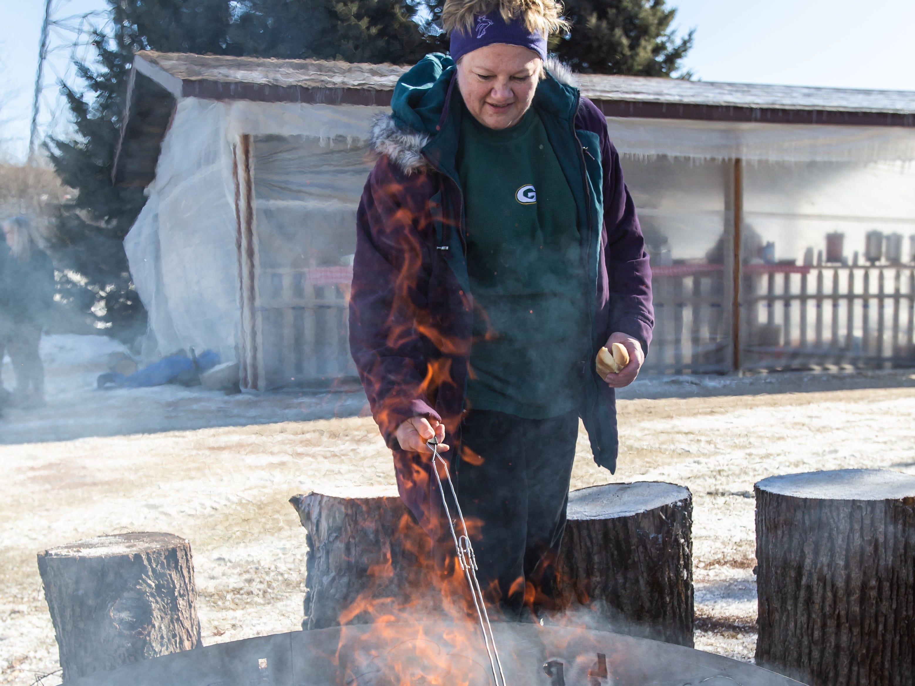Winterfest Chairperson Carol Emmel cooks a hot dog during the annual Winterfest at Lisbon Community Park on Saturday, Feb. 9, 2019. The free event includes ice skating, sledding, skiing, a bonfire, a warming tent with free refreshments, hot dogs and s'mores.