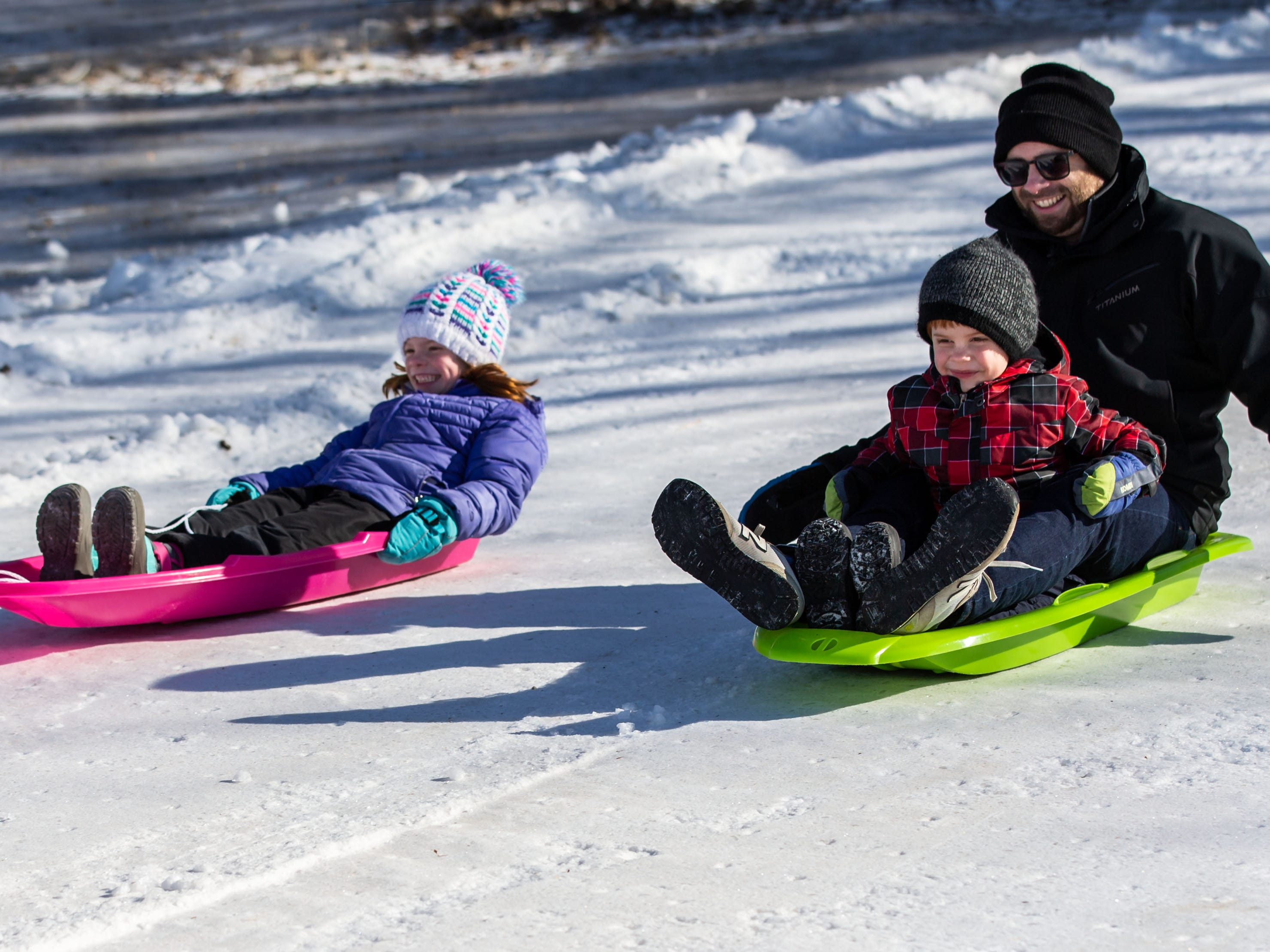 Elsie Ludwig (left), 7, of Oconomowoc races her dad Erik and brother Lucas, 5, down the sledding hill during the annual Winterfest at Lisbon Community Park on Saturday, Feb. 9, 2019. The free event includes ice skating, sledding, skiing, a bonfire, a warming tent with free refreshments, hot dogs and s'mores.