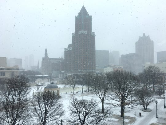 Snow falls over Pere Marquette Park in Milwaukee on Sunday. A winter storm watch has been issued for parts of southeastern and central Wisconsin from Monday evening through Tuesday evening. Four to 8 inches of snow are expected.