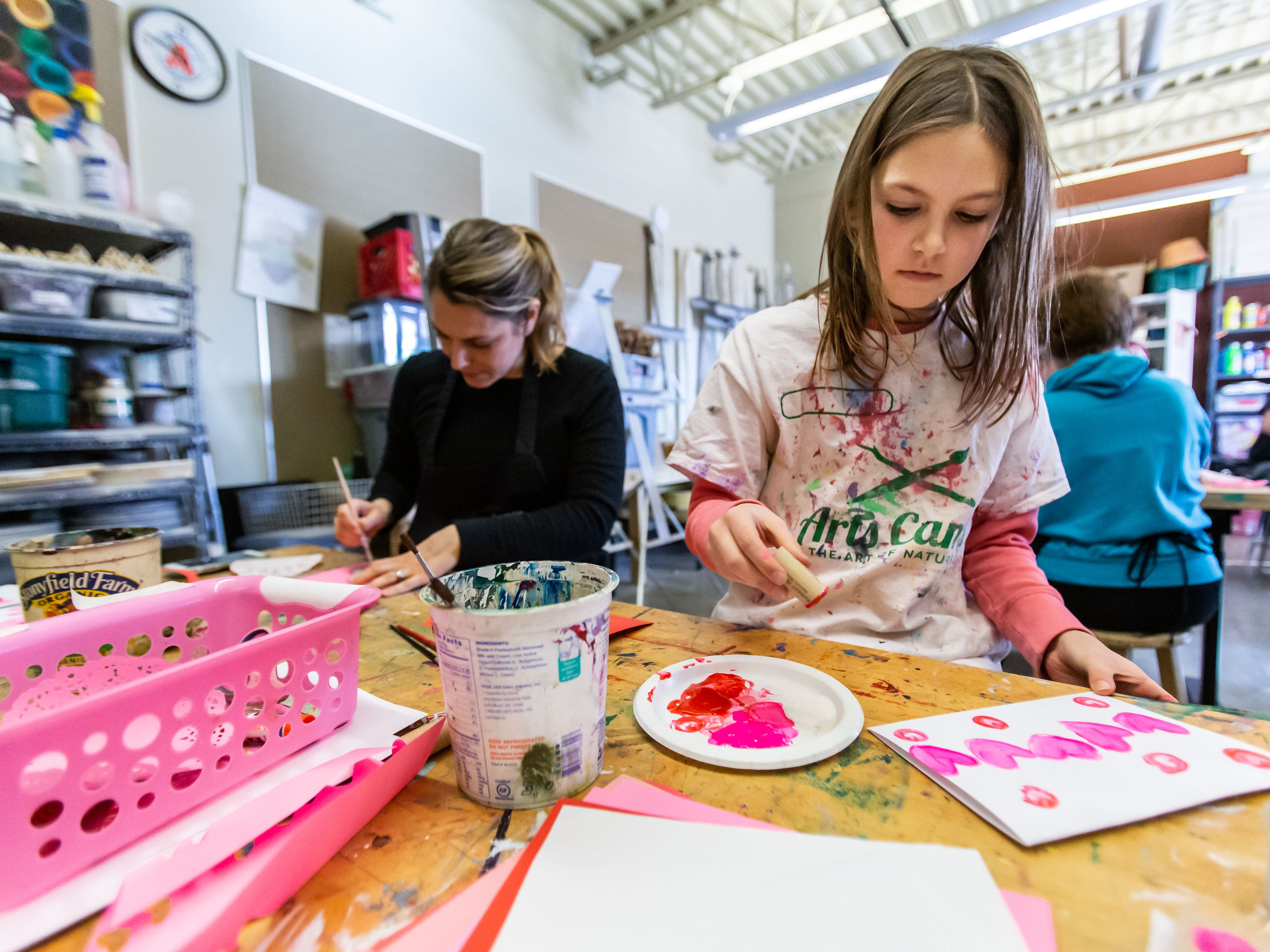 Lauren Miller, 9, of Menomonee Falls and her mother Jackie create printed Valentine's Day cards during the Free Family Art Workshop at the Sharon Lynne Wilson Center for the Arts in Brookfield on Saturday, Feb. 9, 2019. The free art workshops are held from 10 a.m. to noon on the second Saturday of each month. For more info visit wilson-center.com/classes.