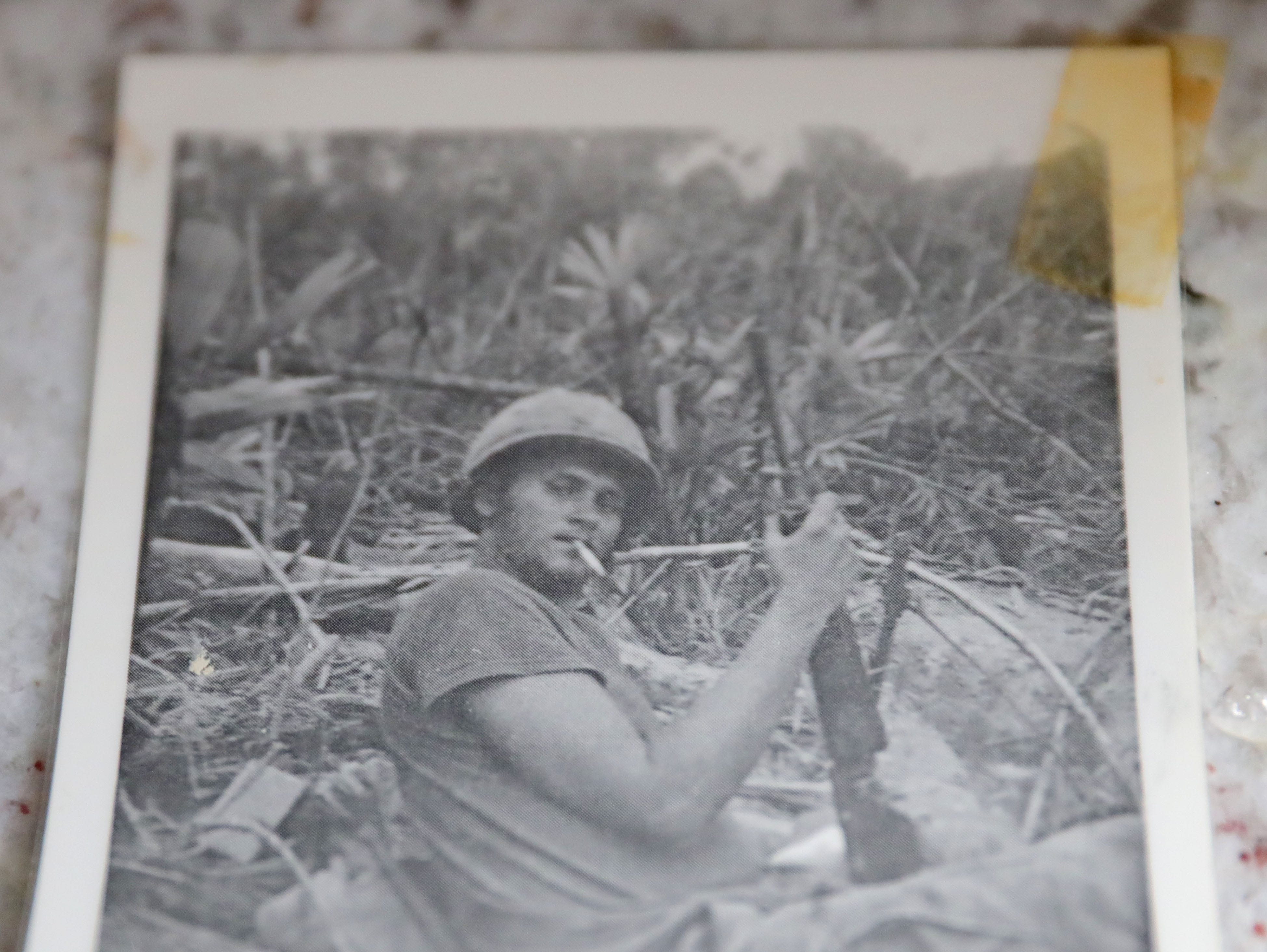 A photo of Wayne R. Thomas, who was killed in Vietnam three days after his 20th birthday in 1969, is seen at the Glendale home of his childhood friend  Gary Weckworth on Tuesday, Feb. 5, 2019. The photo of Thomas is from  November 1969 while on duty in Vietnam. The Milwaukee County War Memorial has started a project to put photos and short biographies of Milwaukee County residents killed in combat on its Roll of Honor.