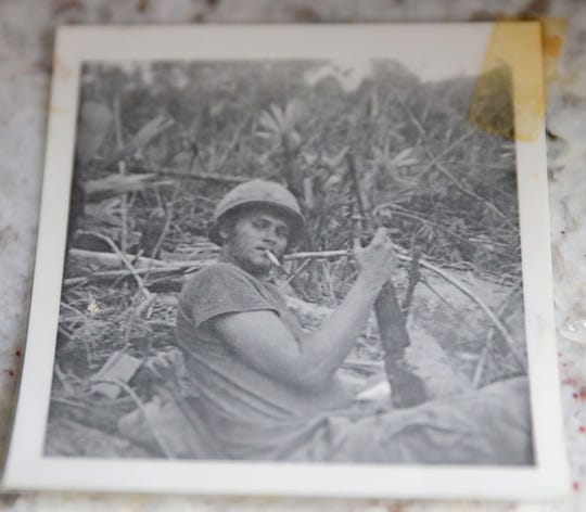 A photo of Wayne R. Thomas, who was killed in Vietnam three days after his 20th birthday in 1969, is seen at the Glendale home of his childhood friend Gary Weckwerth on Tuesday, Feb. 5, 2019. The photo of Thomas was taken in Vietnam. The Milwaukee County War Memorial has started a project to put photos and short biographies of Milwaukee County residents killed in combat on its Roll of Honor.