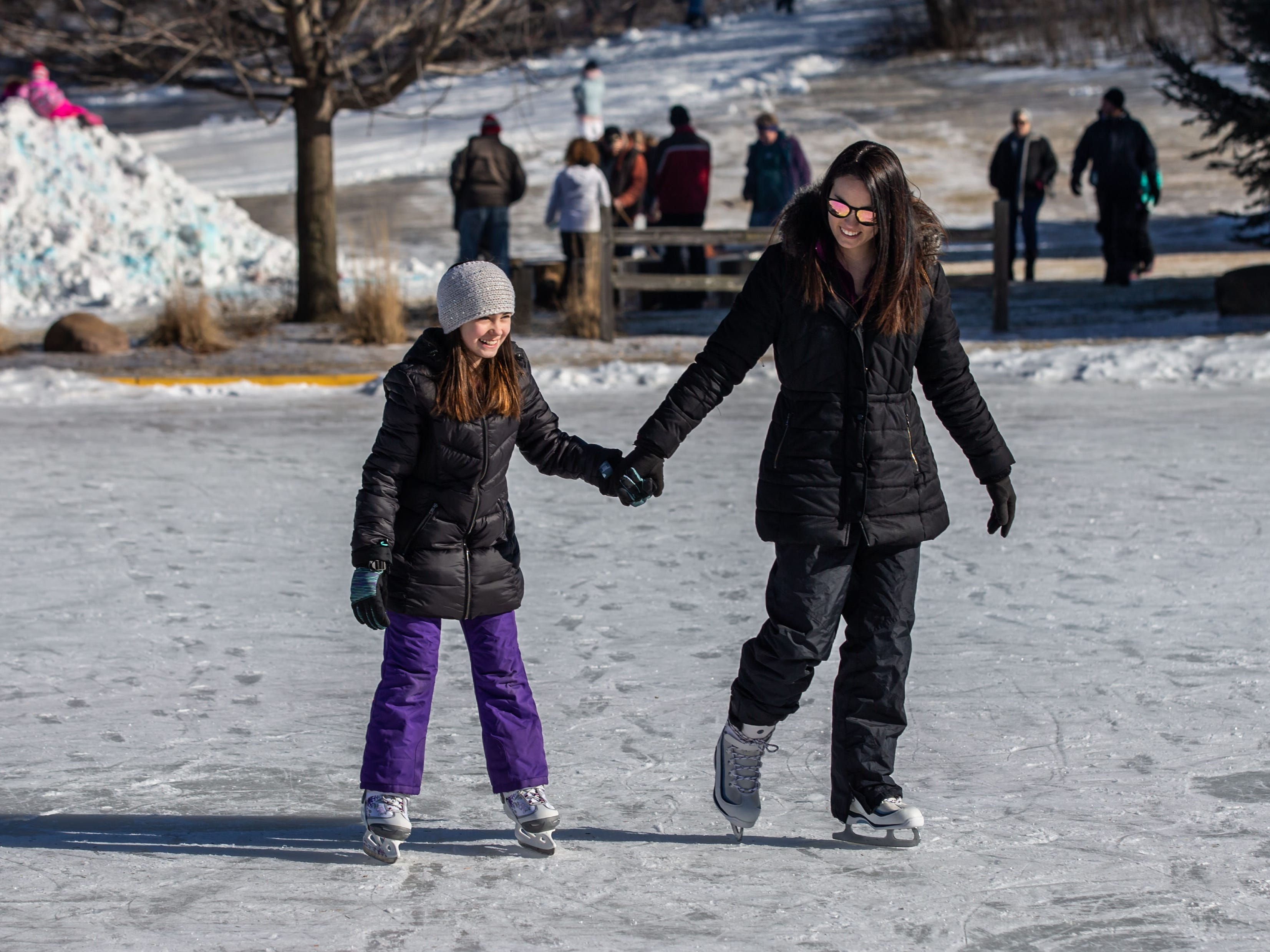 Aubri Schaefer, 9, of Lisbon skates with her mother Sarah during the annual Winterfest at Lisbon Community Park on Saturday, Feb. 9, 2019. The free event includes ice skating, sledding, skiing, a bonfire, a warming tent with free refreshments, hot dogs and s'mores.
