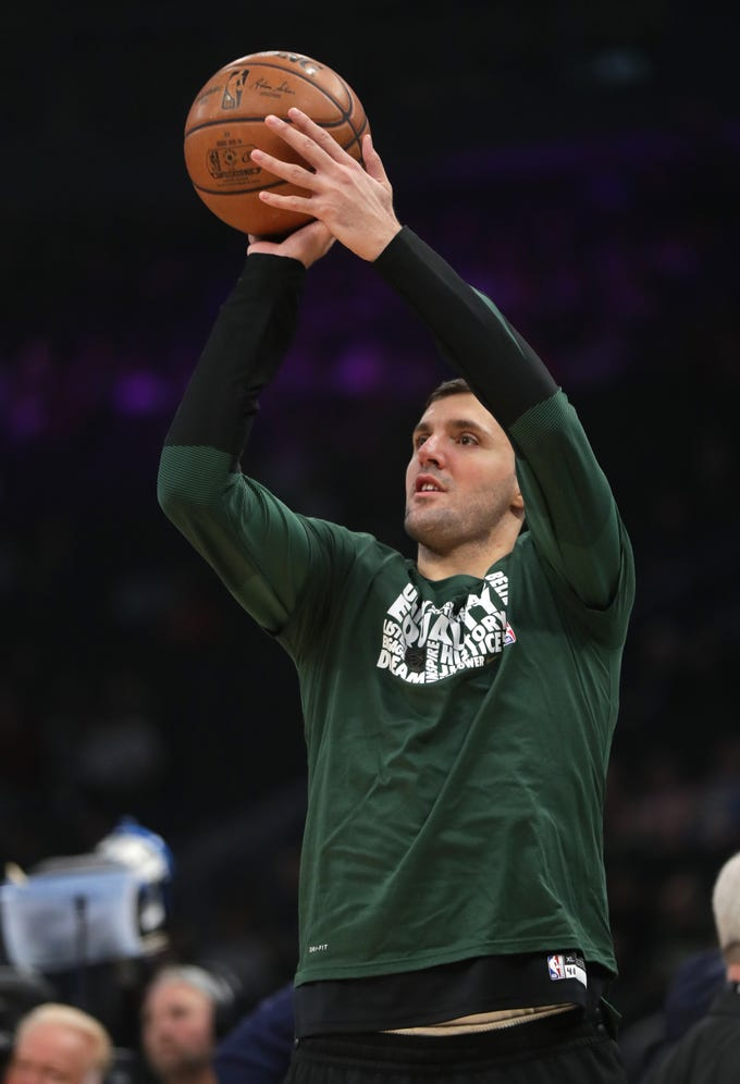 Newly acquired Bucks forward Nikola Mirotic takes part in the shootaround before Milwaukee's game against the Orlando Magic on Saturday at Fiserv Forum. Mirotic was held out of the game as he's still recovering from a calf injury.