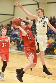 Norfork's Blythe Stapleton goes up against Izard County's Gunner Gleghorn in the 1A-2 District championship Saturday at Omaha.