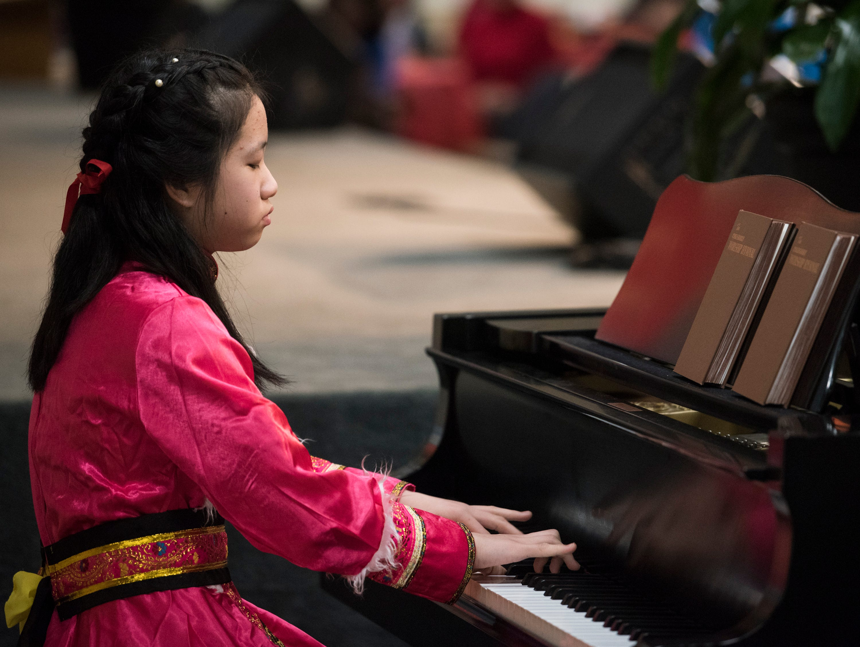Reena Chen performs during the Central Alabama Association of Chinese 2019 Montgomery Chinese New Year festsival at Frazer Church in Montgomery, Ala., on Saturday, Feb. 9, 2019.