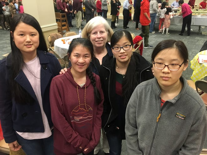 Montgomery mother Vicky Simpson with her adopted daughters, from left,  MacKinley, Eden, Journey and Kendall, Saturday at the CAAC Chinese New Year celebration at Frazer UMC in Montgomery.