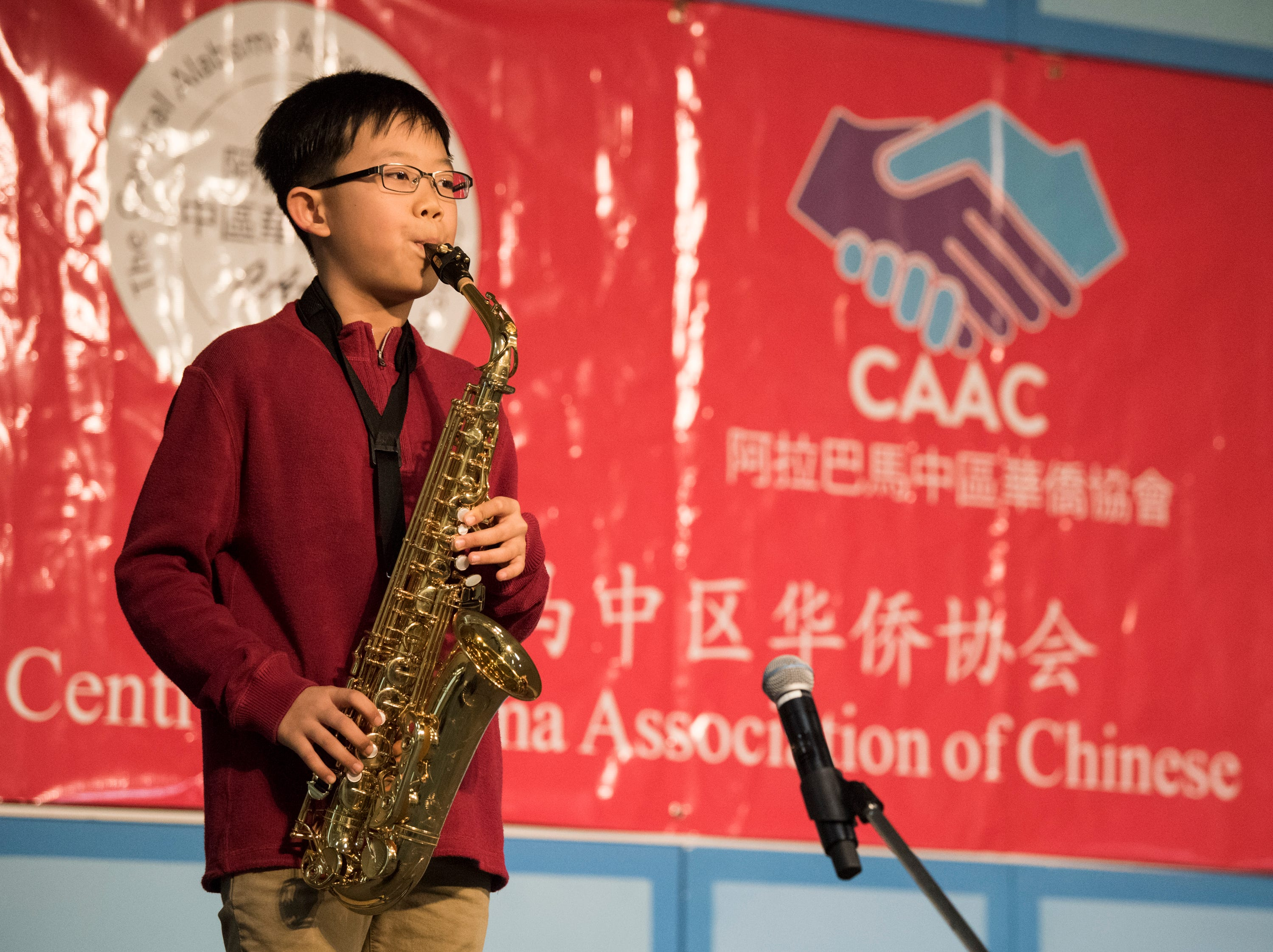 Edwin Chen performs during the Central Alabama Association of Chinese 2019 Montgomery Chinese New Year festsival at Frazer Church in Montgomery, Ala., on Saturday, Feb. 9, 2019.