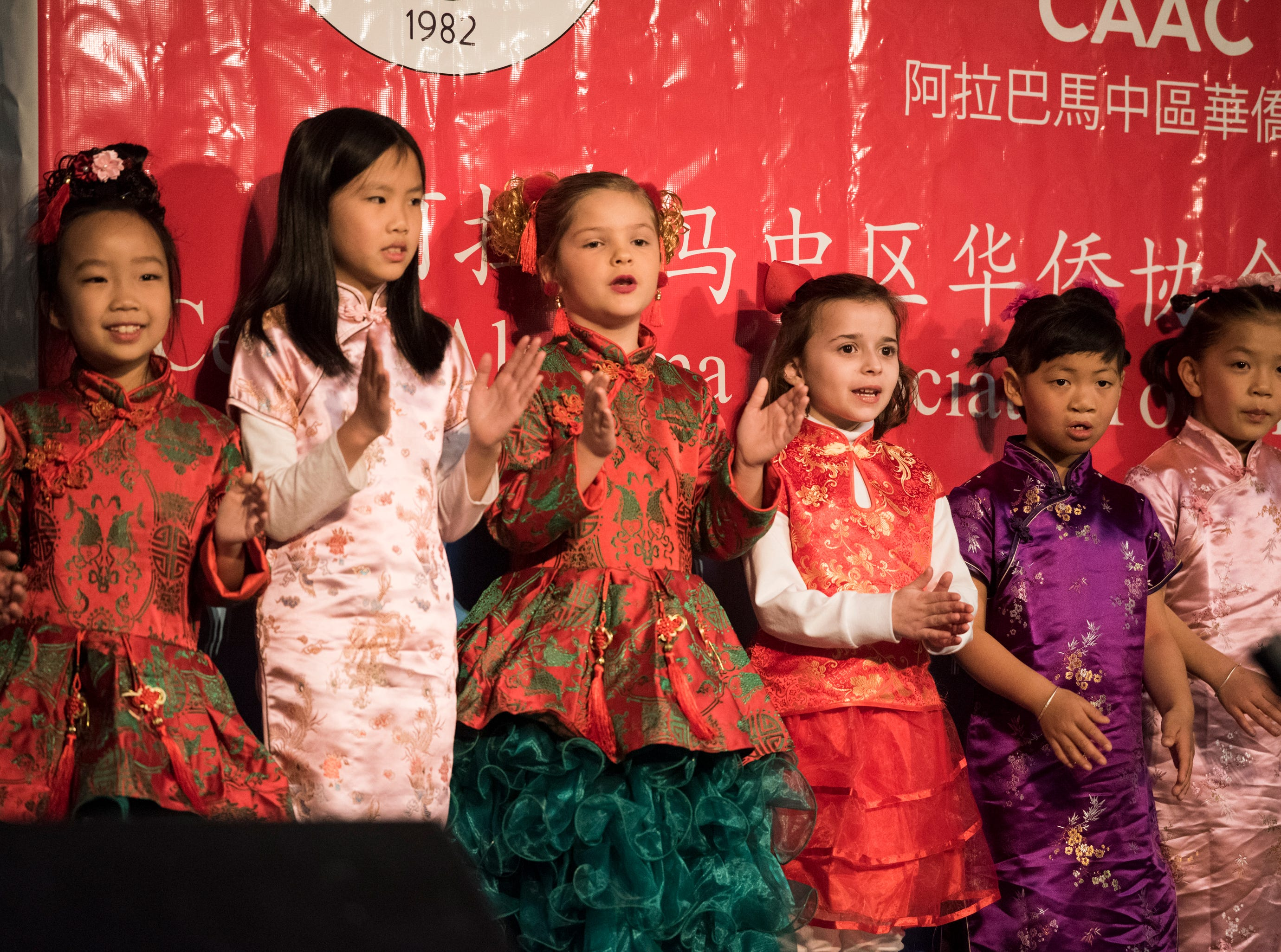 Kids sing during the Central Alabama Association of Chinese 2019 Montgomery Chinese New Year festsival at Frazer Church in Montgomery, Ala., on Saturday, Feb. 9, 2019.