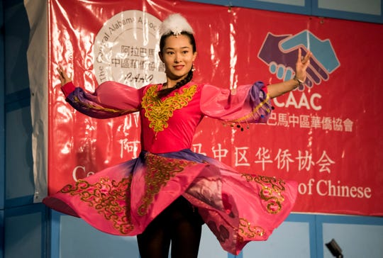 Janice Yang performs an Uyghur ethnic dance during the Central Alabama Association of Chinese 2019 Montgomery Chinese New Year festsival at Frazer Church in Montgomery, Ala., on Saturday, Feb. 9, 2019.