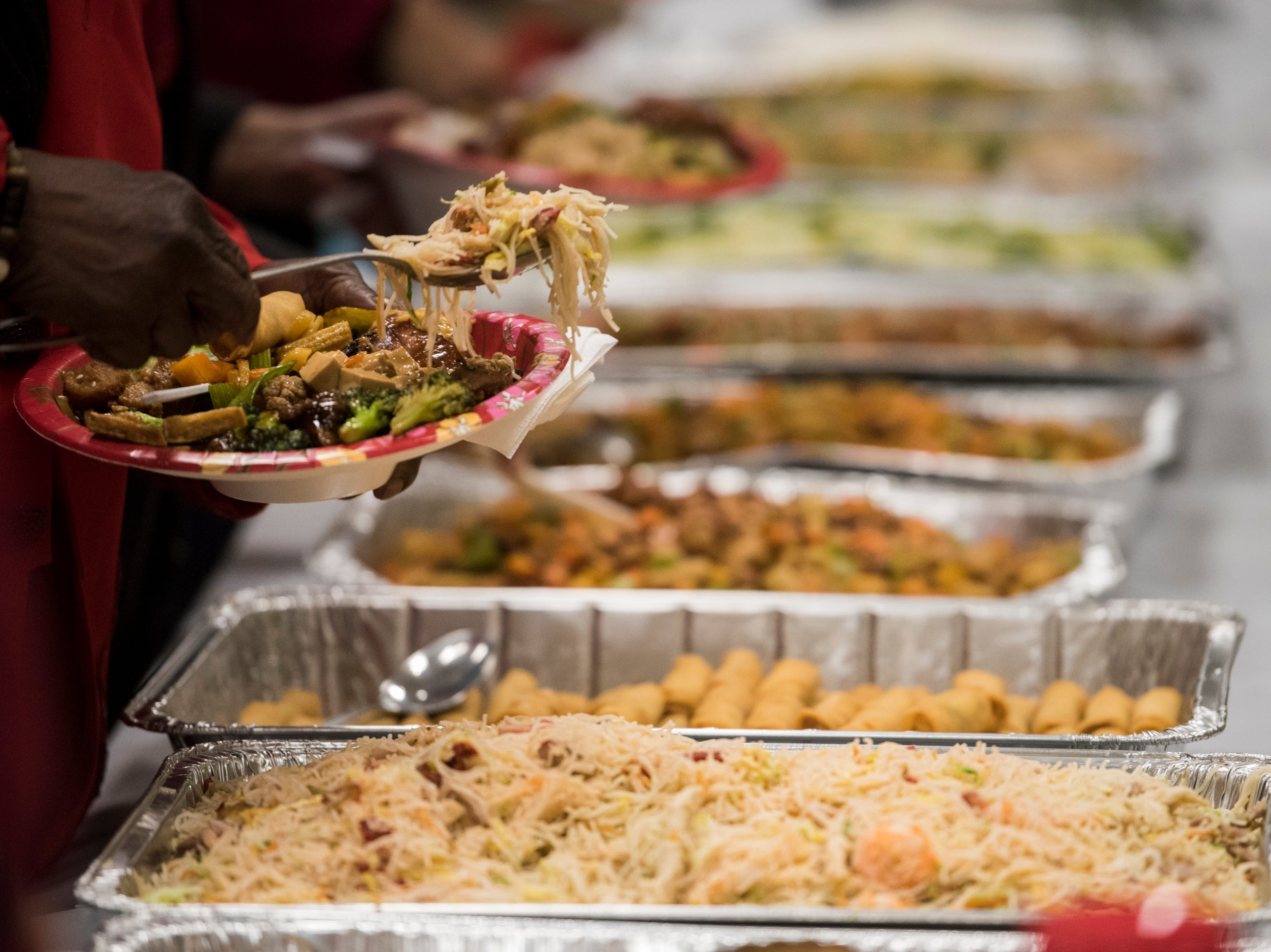 Food is served during the Central Alabama Association of Chinese 2019 Montgomery Chinese New Year festsival at Frazer Church in Montgomery, Ala., on Saturday, Feb. 9, 2019.