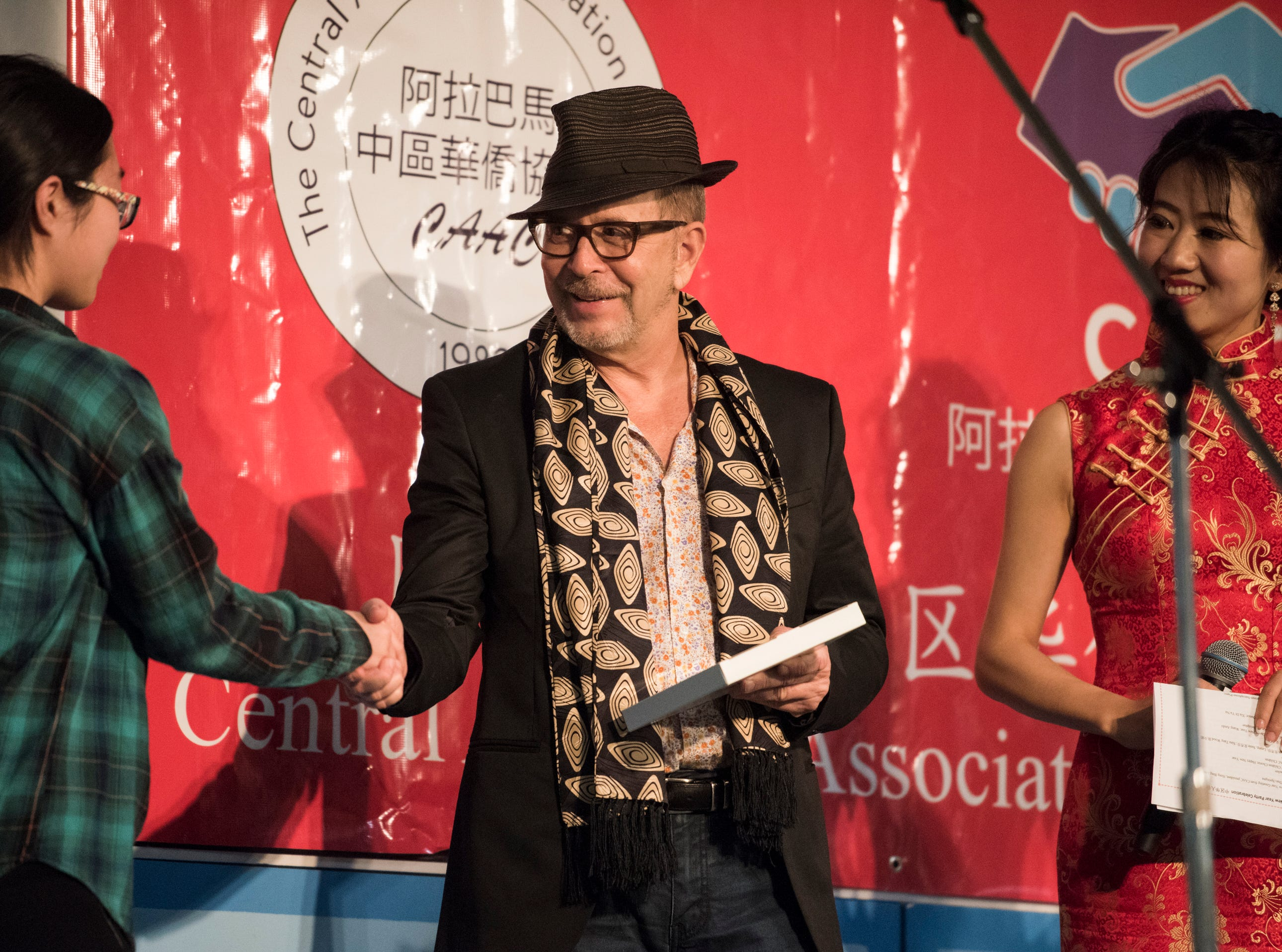 Film editor Barry Alexander Brown presents award as the special guest during the Central Alabama Association of Chinese 2019 Montgomery Chinese New Year festsival at Frazer Church in Montgomery, Ala., on Saturday, Feb. 9, 2019.