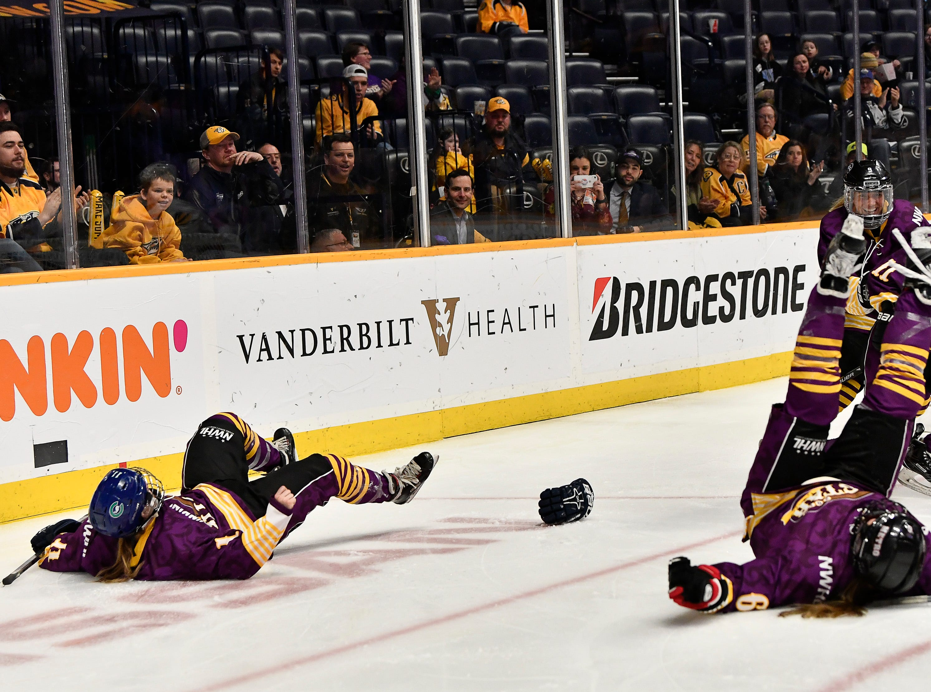 Team Stecklein's Emily Fluke and teammates celebrate their goal during the second half of the NWHL All Star game at Bridgestone Arena Sunday Feb. 10, 2019 in Nashville, Tenn.