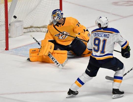 Blues right wing Vladimir Tarasenko (91) shoots a goal past goaltender Juuse Saros (74) to defeat the Predators 5-4 in overtime Sunday.