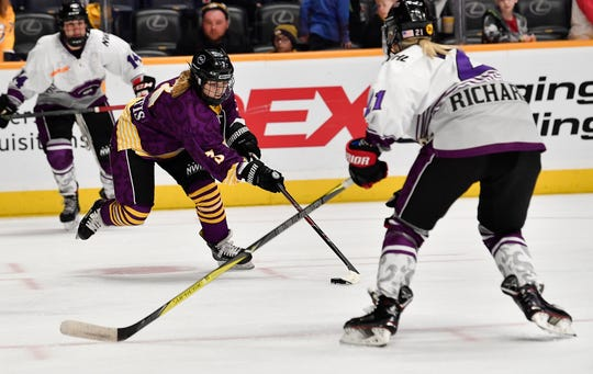 Team Stecklein's Jonna Curtis passes the puck past Team Szabados defender during the second half of the NWHL All Star game at Bridgestone Arena Sunday Feb. 10, 2019 in Nashville, Tenn.