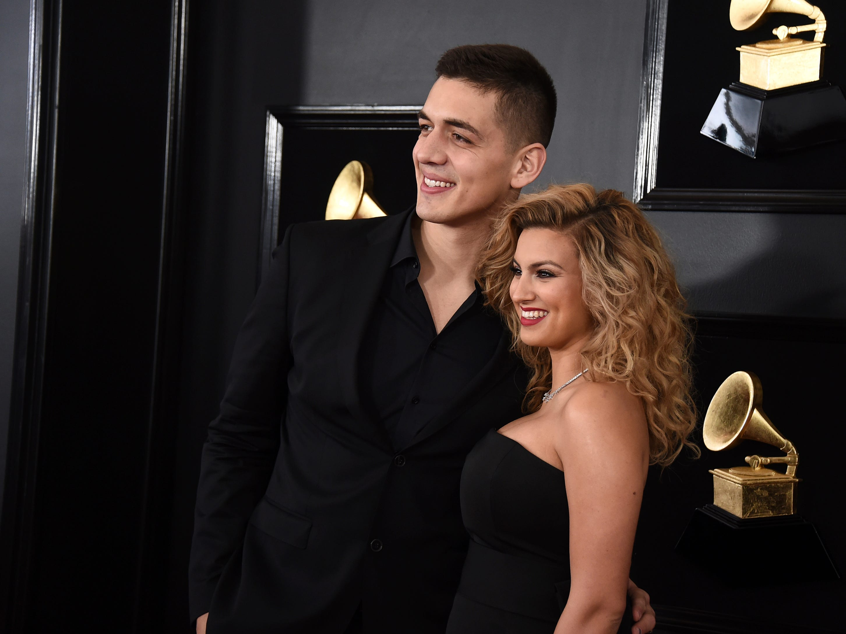 Andre Murillo, left, and Tori Kelly arrive at the 61st annual Grammy Awards at the Staples Center on Sunday, Feb. 10, 2019, in Los Angeles.