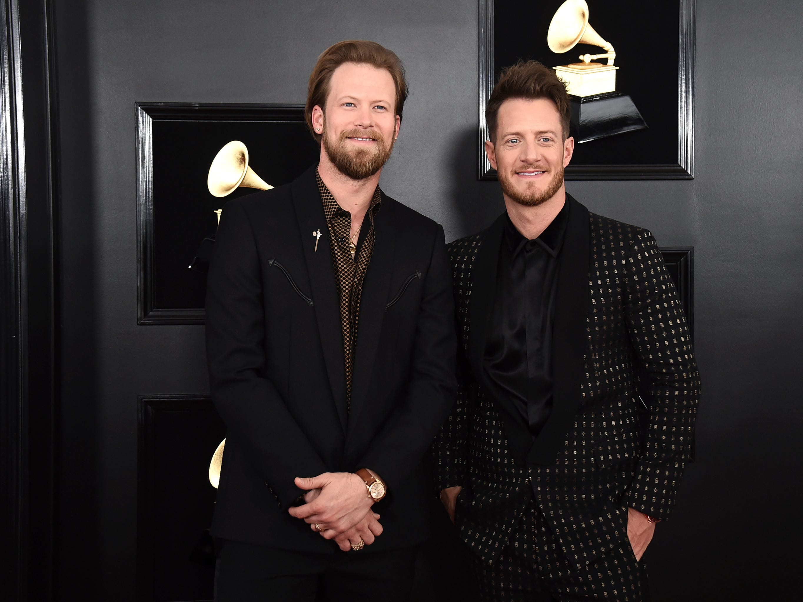 Brian Kelley, left, and Tyler Hubbard of Florida Georgia Line arrive at the 61st annual Grammy Awards at the Staples Center on Sunday, Feb. 10, 2019, in Los Angeles.