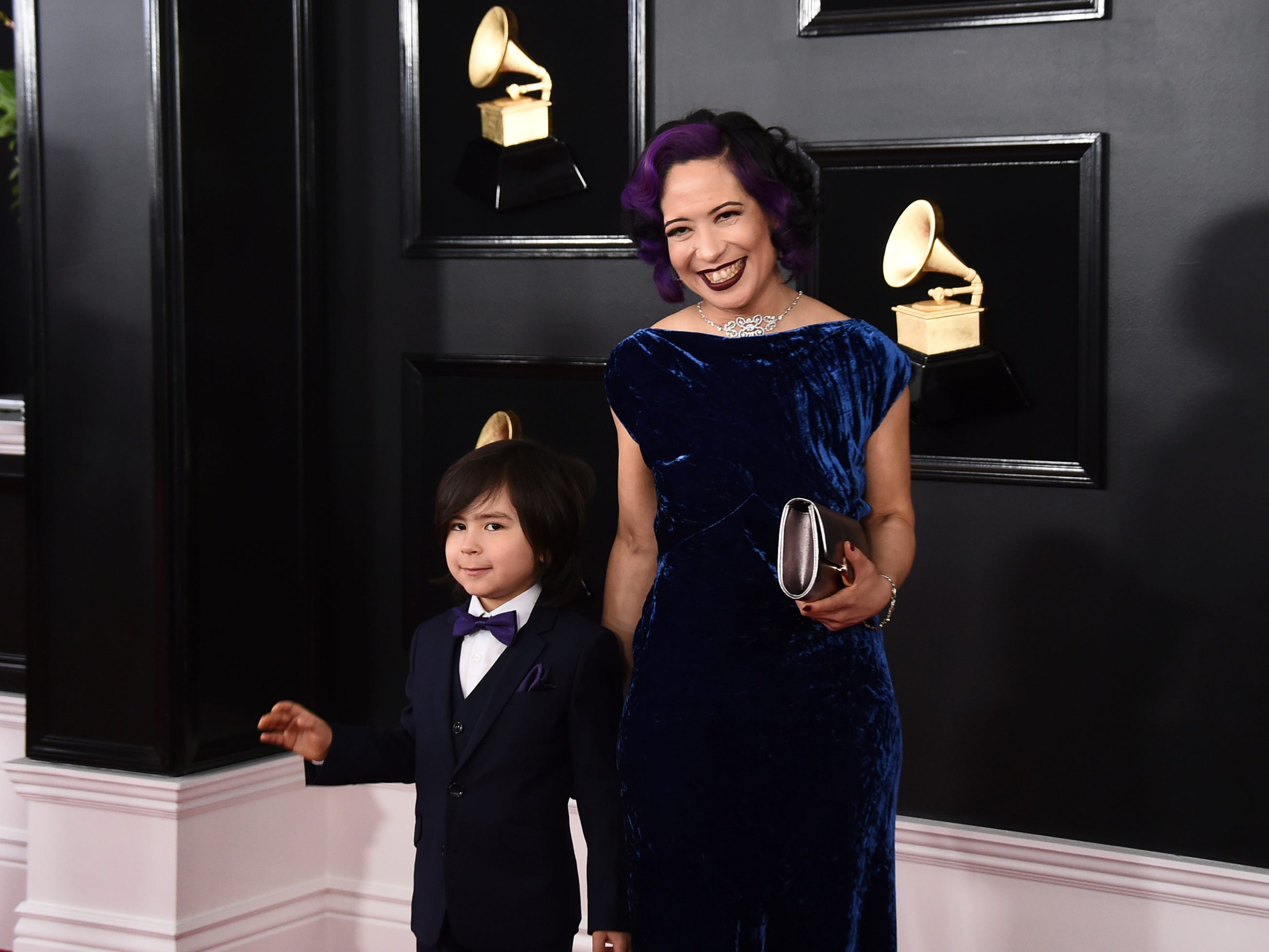 Darius Kalantari, left, and Lucy Kalantari arrive at the 61st annual Grammy Awards at the Staples Center on Sunday, Feb. 10, 2019, in Los Angeles.