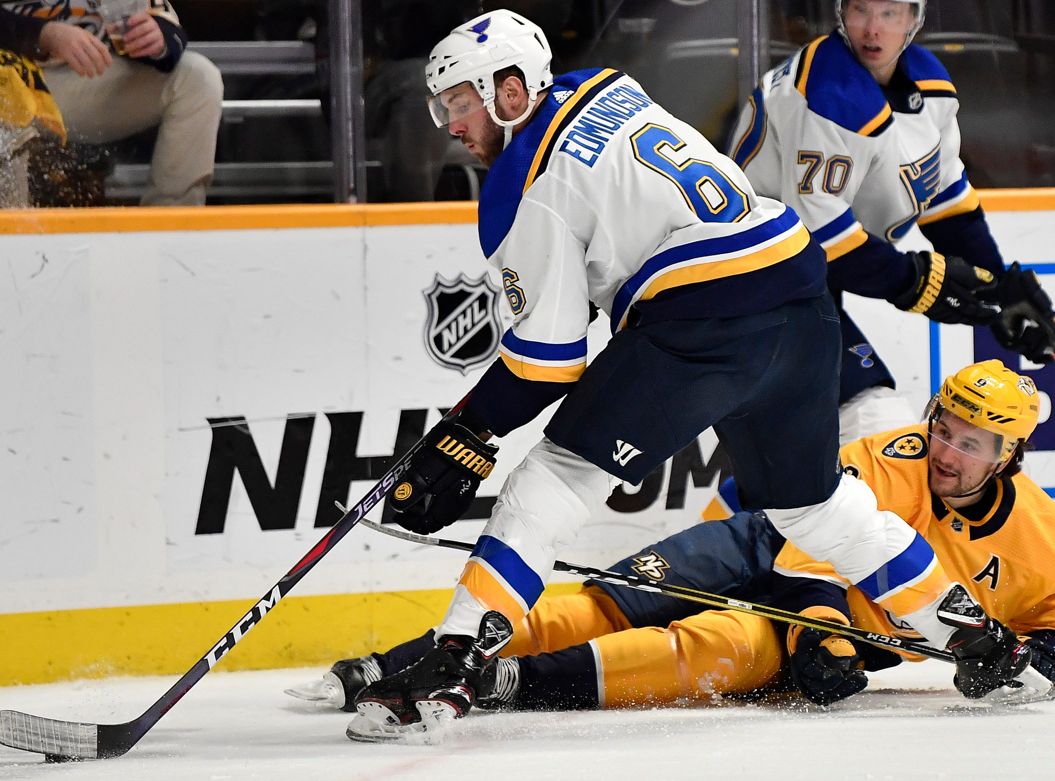 Predators left wing Filip Forsberg (9) tries to get the puck from Blues defenseman Joel Edmundson (6) during the first period at Bridgestone Arena Sunday Feb. 10, 2019 in Nashville, Tenn.