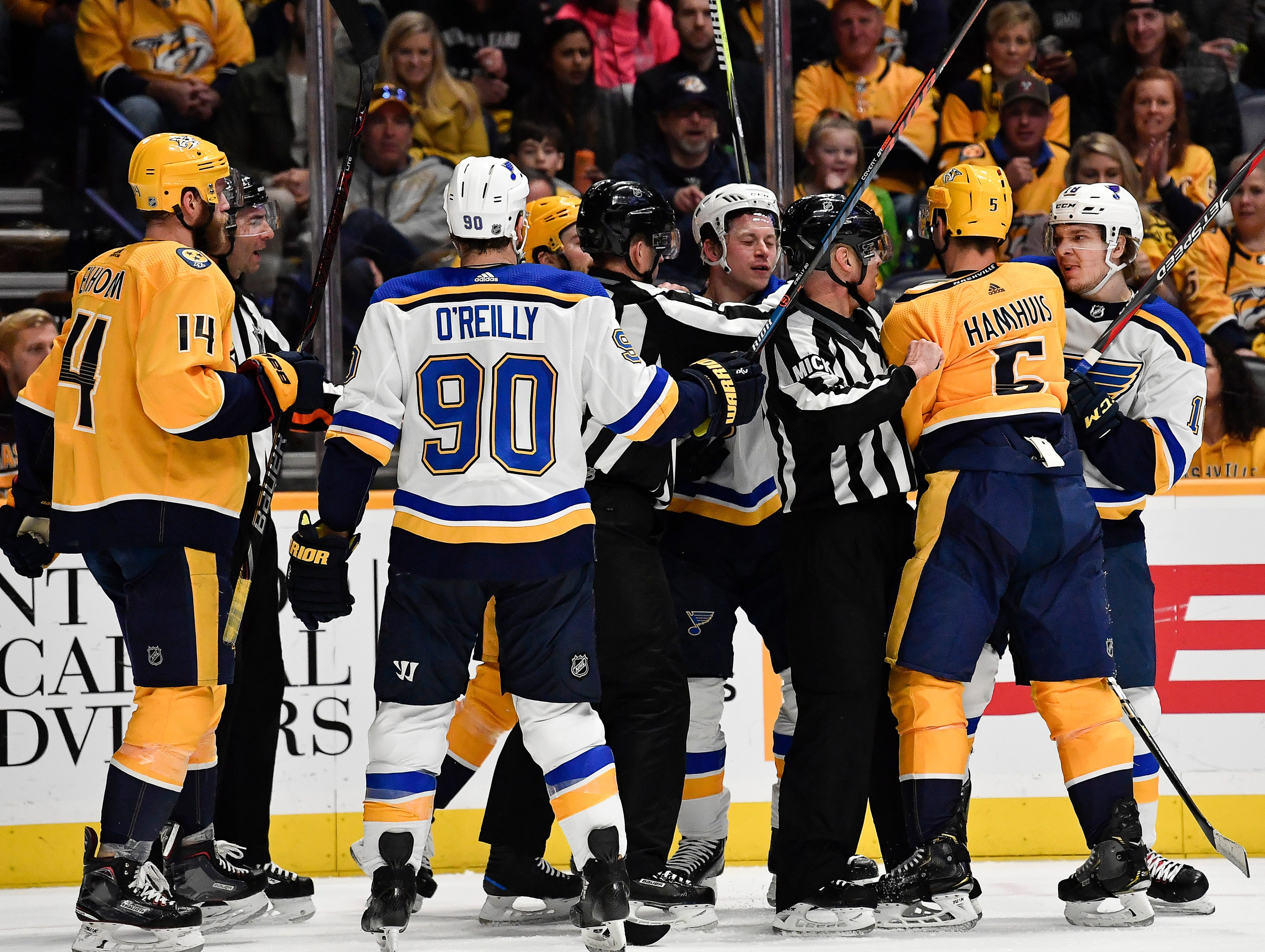 Referees separate Blues players and Predators players as they scuffle during the second period at Bridgestone Arena Sunday Feb. 10, 2019 in Nashville, Tenn.