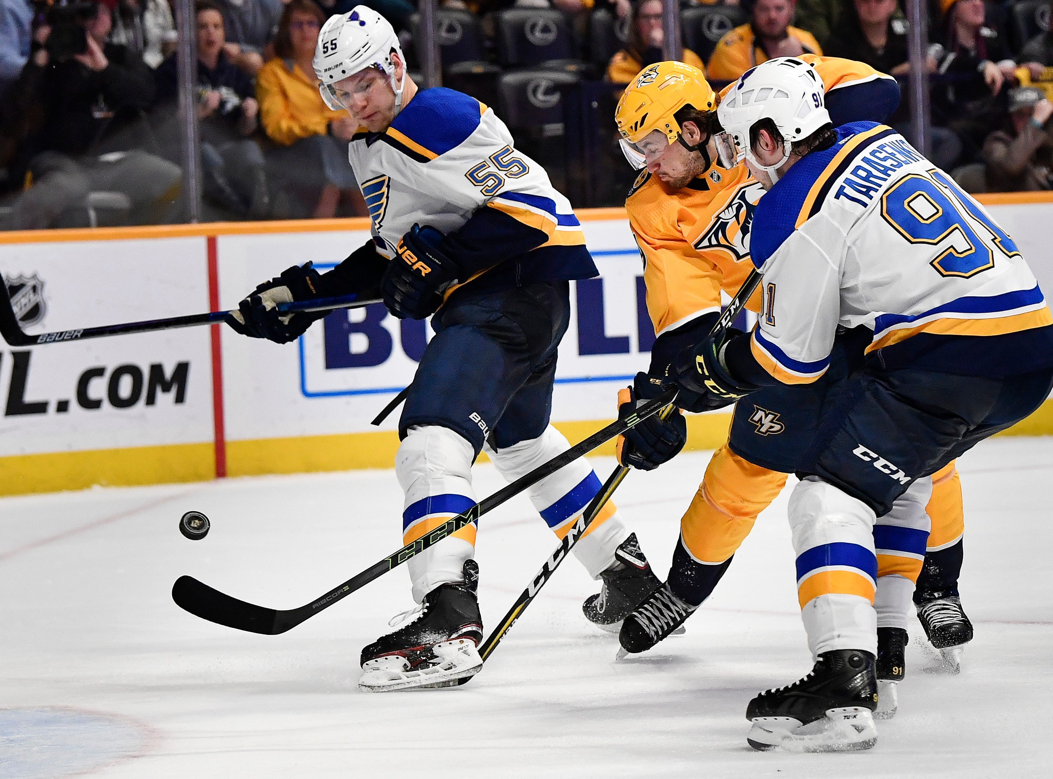 Predators left wing Filip Forsberg (9) shoots a goal past Blues defenseman Colton Parayko (55) and right wing Vladimir Tarasenko (91) during the third period at Bridgestone Arena Sunday Feb. 10, 2019 in Nashville, Tenn.