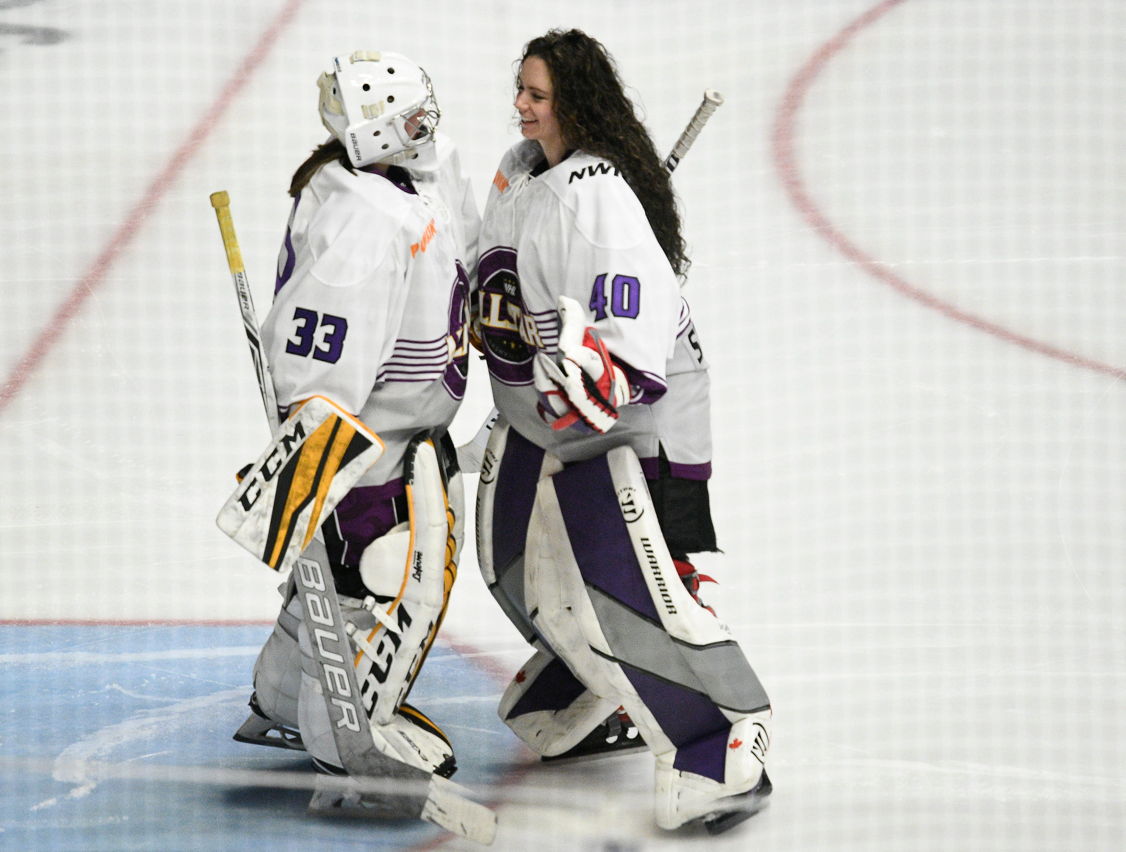 Team Szabados goalies Katie Burt and Shannon Szabdos greet each other before their game against Team Stecklein in the NWHL All Star game at Bridgestone Arena Sunday Feb. 10, 2019 in Nashville, Tenn.