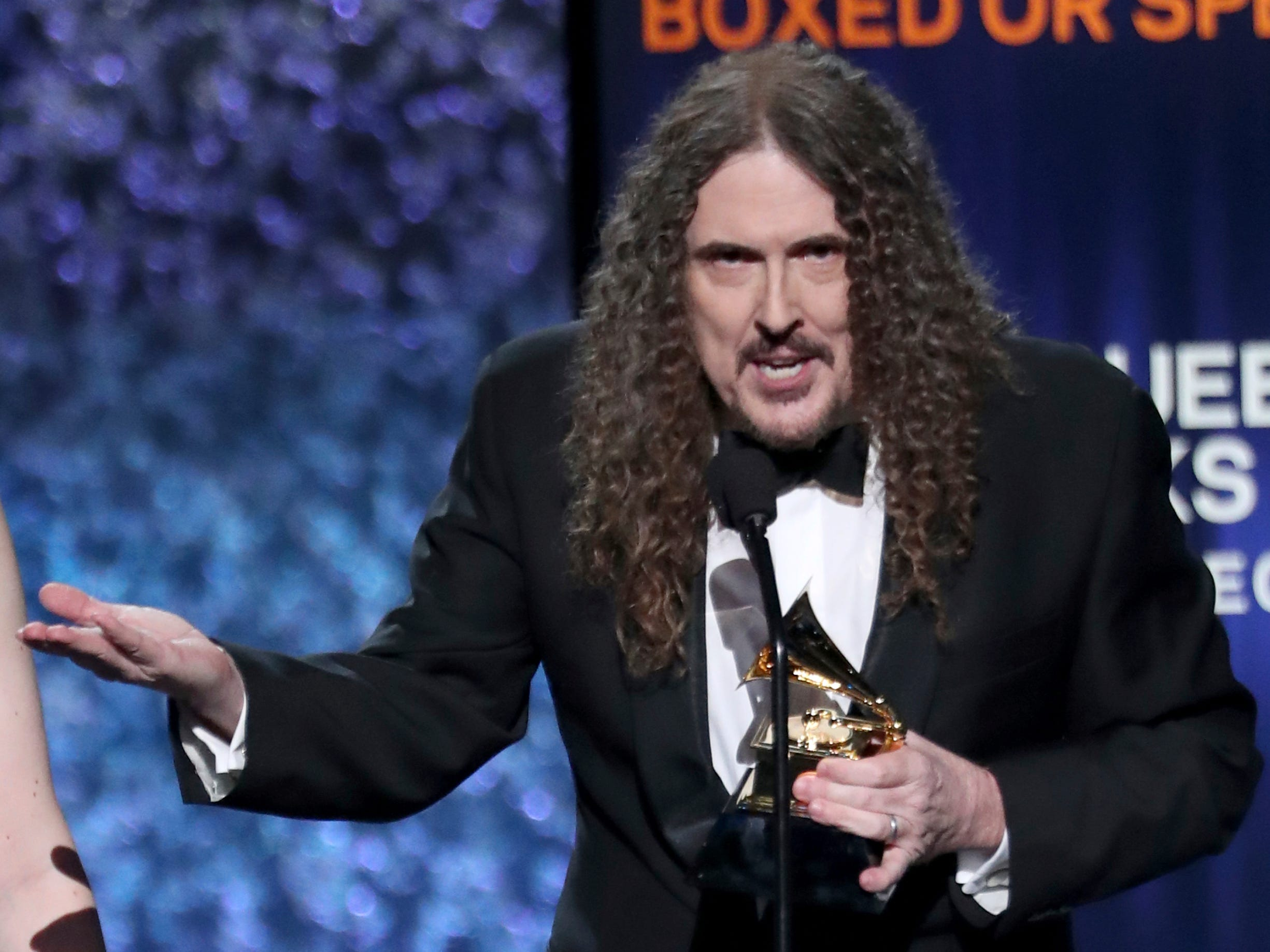 """Weird Al"" Yankovic accepts the award for best boxed or special limited edition package for ""Squeeze Box: The Complete Works of 'Weird Al' Yankovic"" at the 61st annual Grammy Awards on Sunday, Feb. 10, 2019, in Los Angeles."