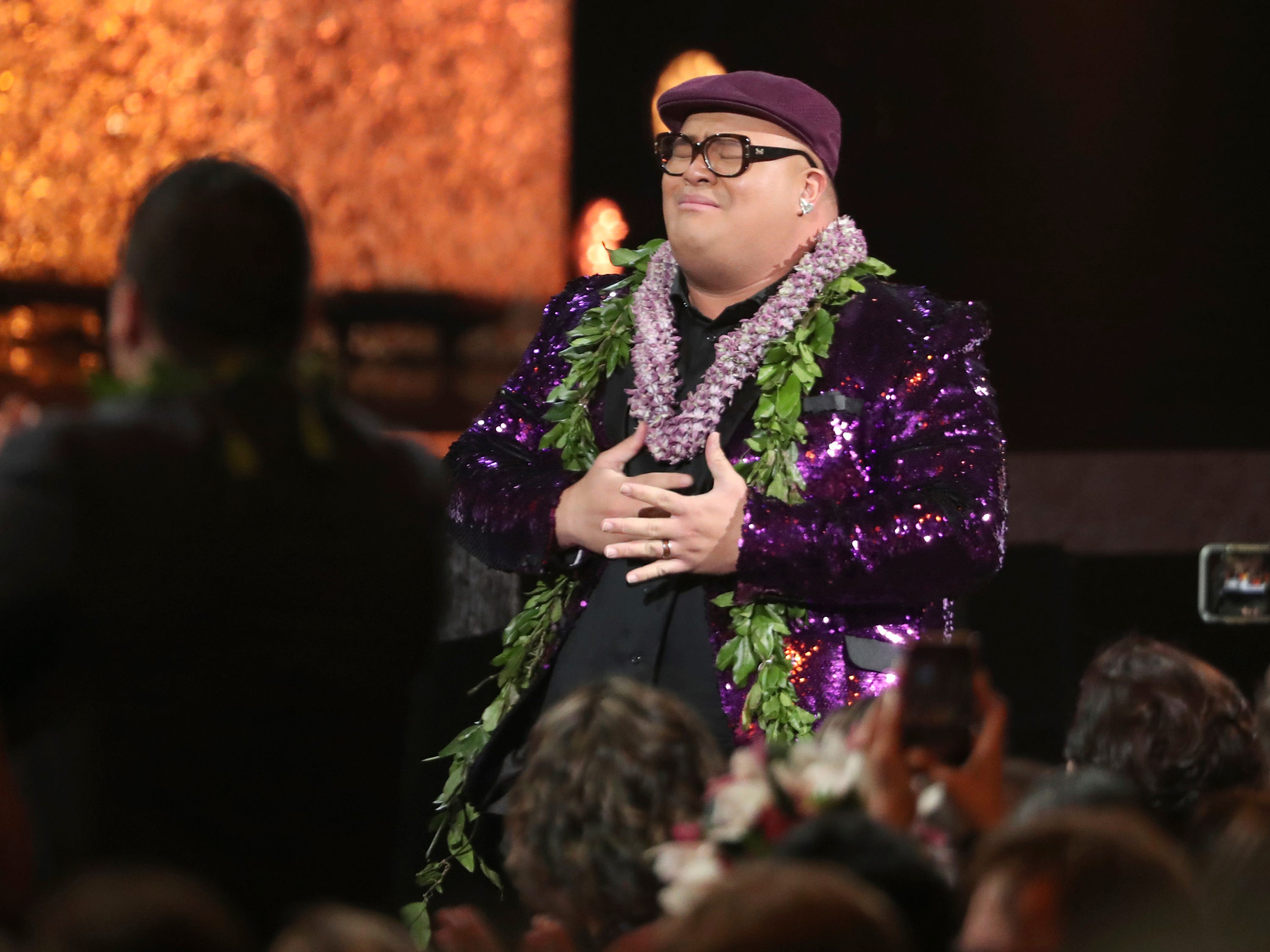 "Kalani Pe'a walks on stage to accept the award for best regional roots music album for ""No 'Ane'i"" at the 61st annual Grammy Awards on Sunday, Feb. 10, 2019, in Los Angeles."
