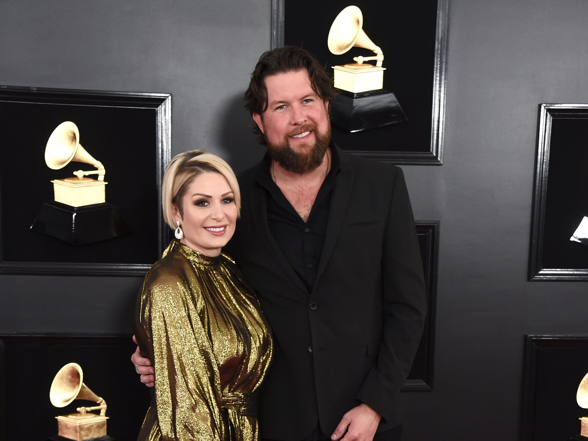 Zach Williams, right, and Crystal Williams arrive at the 61st annual Grammy Awards at the Staples Center on Sunday, Feb. 10, 2019, in Los Angeles.