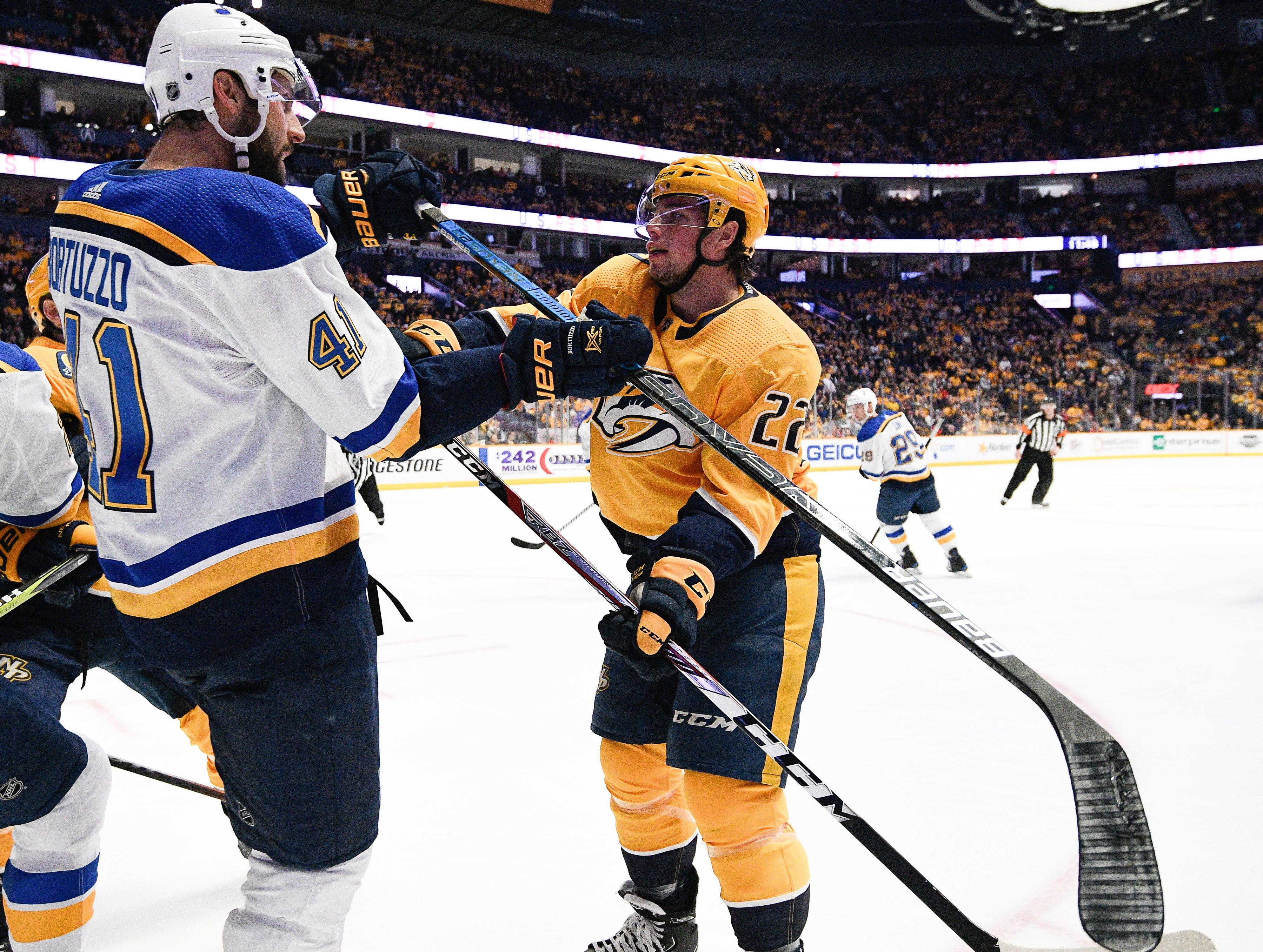 Blues defenseman Robert Bortuzzo (41) and Predators left wing Kevin Fiala (22) get into a shoving match during the first period at Bridgestone Arena Sunday Feb. 10, 2019 in Nashville, Tenn.
