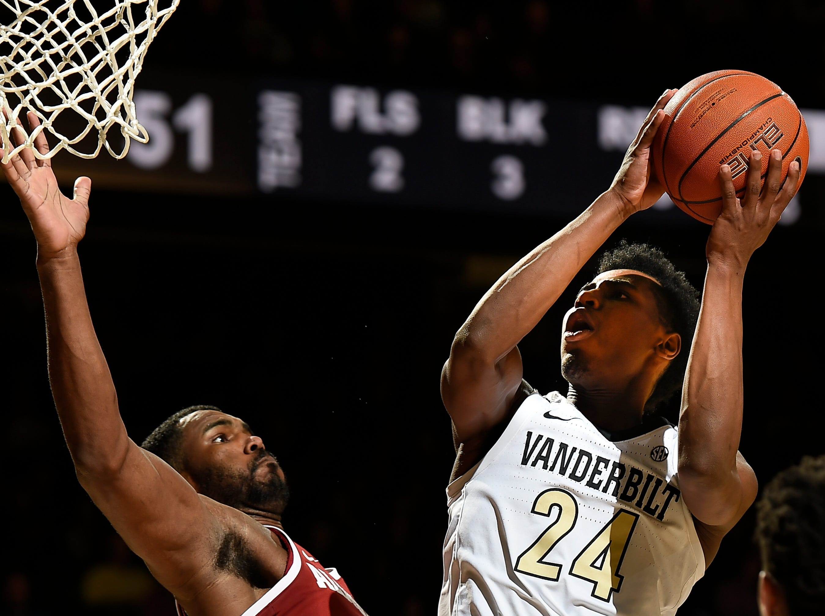 Vanderbilt forward Aaron Nesmith (24) shoots over Alabama forward Daniel Giddens (4) during the second half at Memorial Gym Saturday Feb. 9, 2019 in Nashville, Tenn.