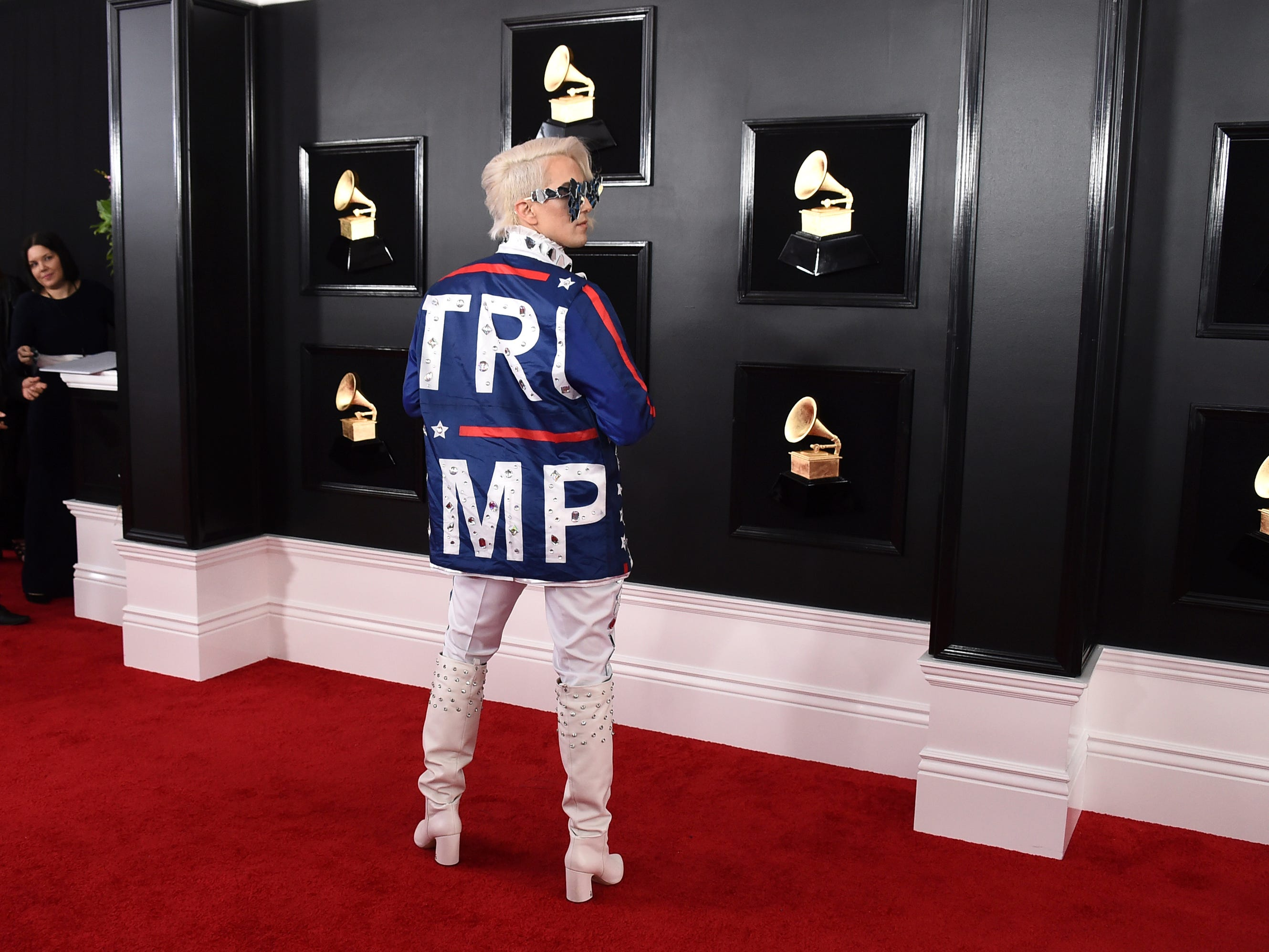 Ricky Rebel arrives at the 61st annual Grammy Awards at the Staples Center wearing a jacket with the word Trump on it, on Sunday, Feb. 10, 2019, in Los Angeles.