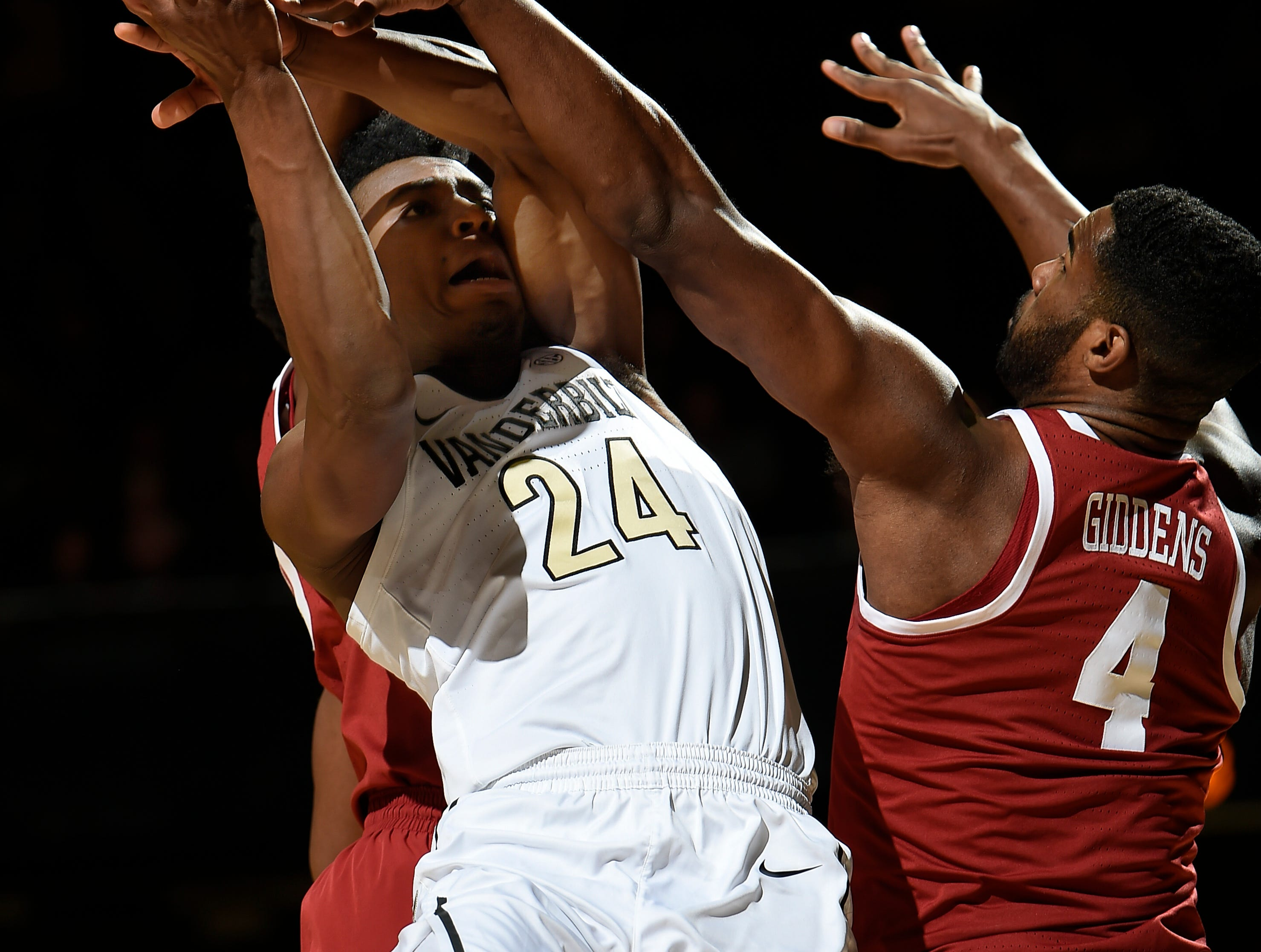 Vanderbilt forward Aaron Nesmith (24) is fouled by Alabama forward Daniel Giddens (4) as he shoots during the first half at Memorial Gym Saturday Feb. 9, 2019 in Nashville, Tenn.