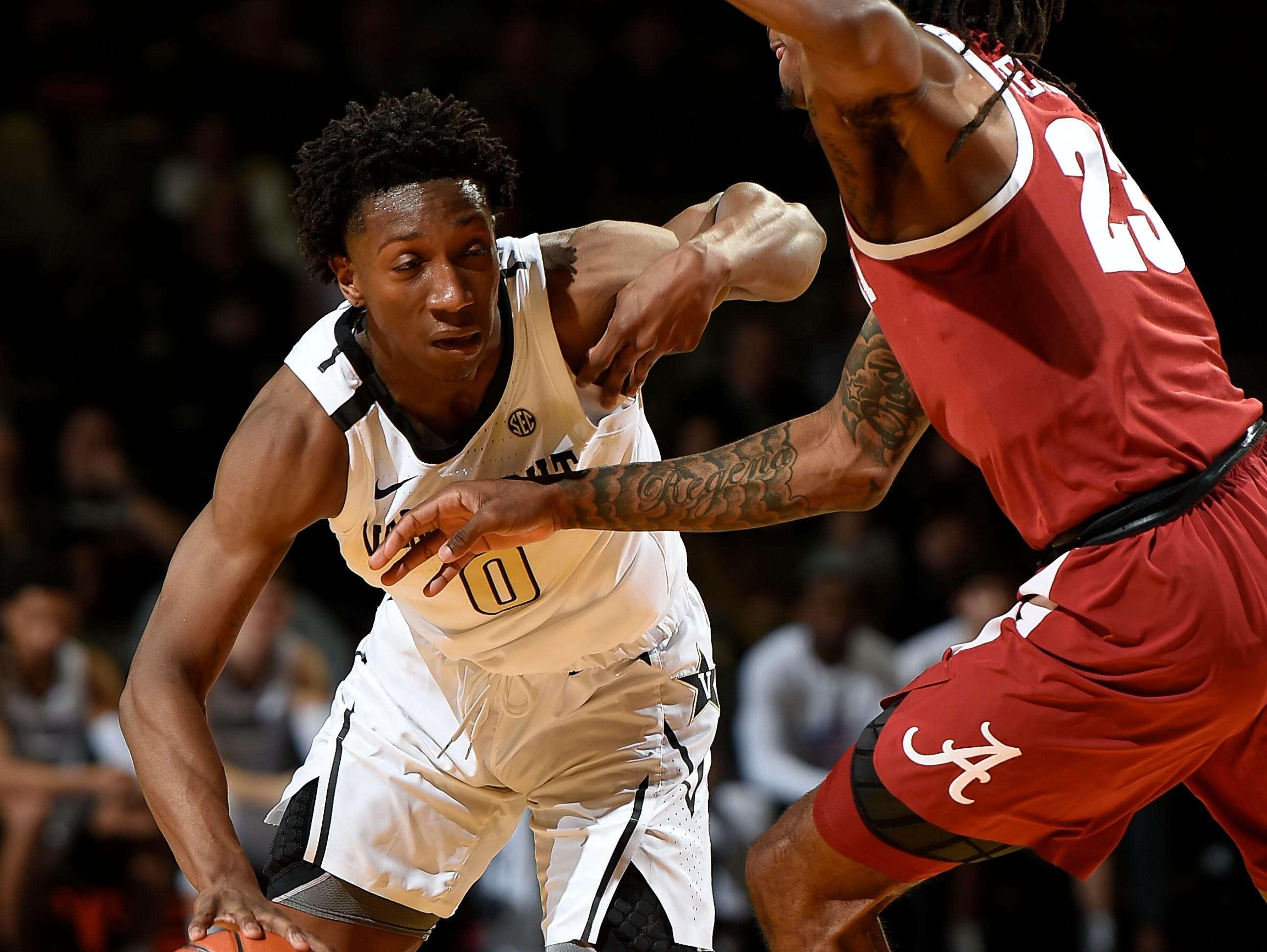 Vanderbilt guard Saben Lee (0) drives past Alabama guard John Petty (23) during the first half at Memorial Gym Saturday Feb. 9, 2019 in Nashville, Tenn.