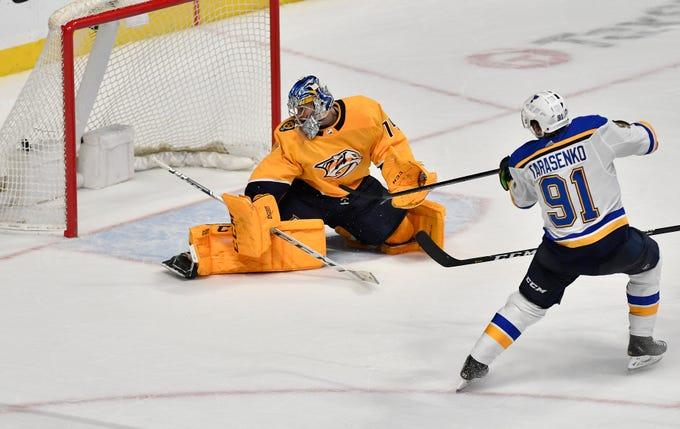 Blues right wing Vladimir Tarasenko (91) shoots a goal past goaltender Juuse Saros (74) to defeat the Predators 5 to 4 during overtime at Bridgestone Arena Sunday Feb. 10, 2019 in Nashville, Tenn.
