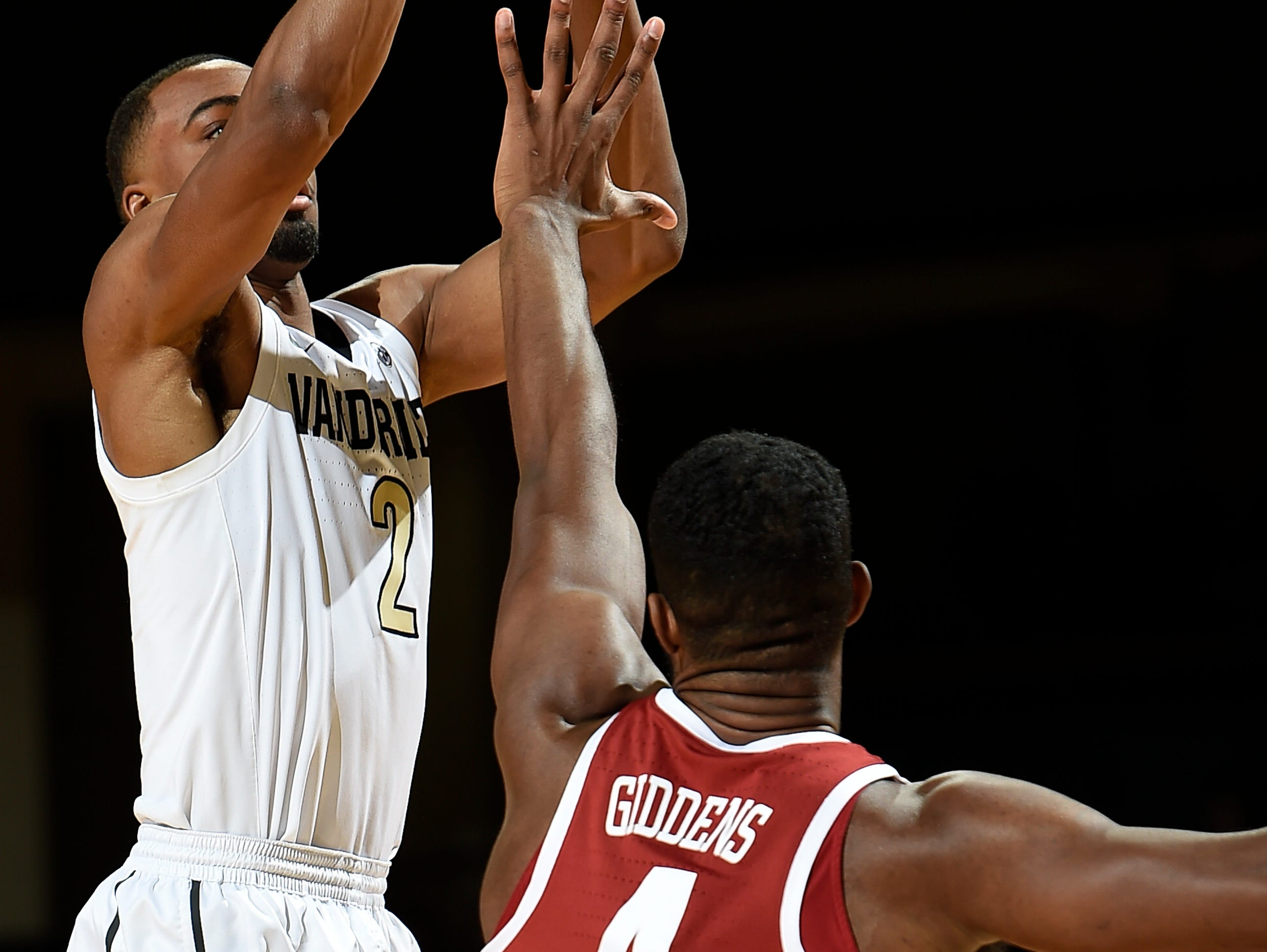 Vanderbilt guard Joe Toye (2) shoots over Alabama forward Daniel Giddens (4) during the first half at Memorial Gym Saturday Feb. 9, 2019 in Nashville, Tenn.